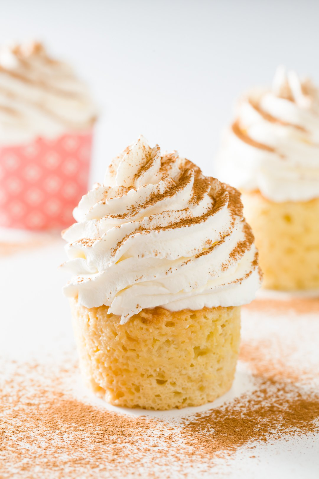 A group of three tres leches cupcakes