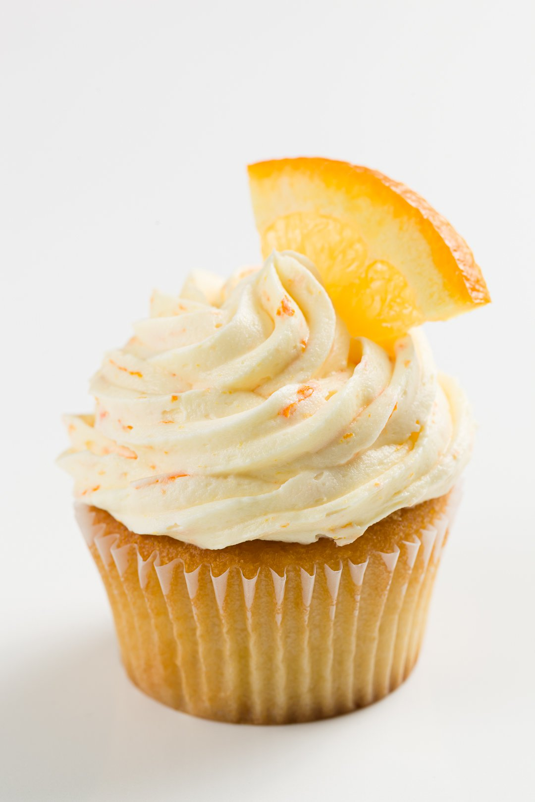 cupcake frosted with orange buttercream