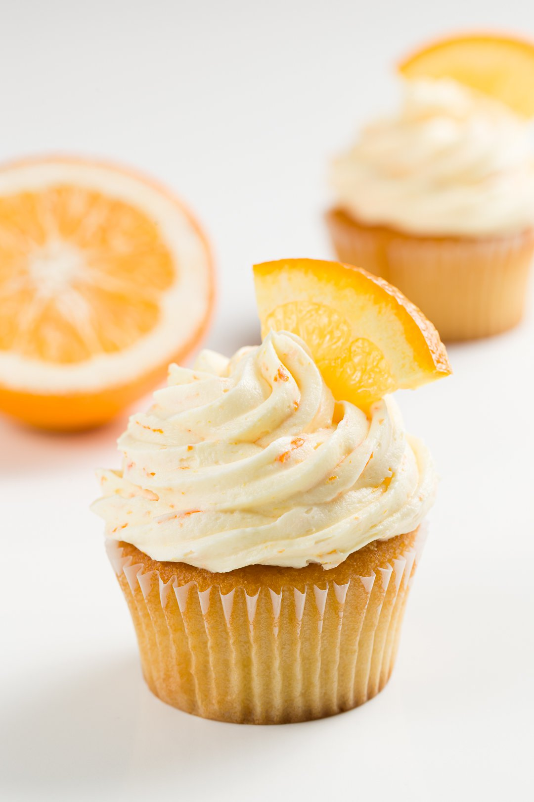 Orange frosting on vanilla cupcakes