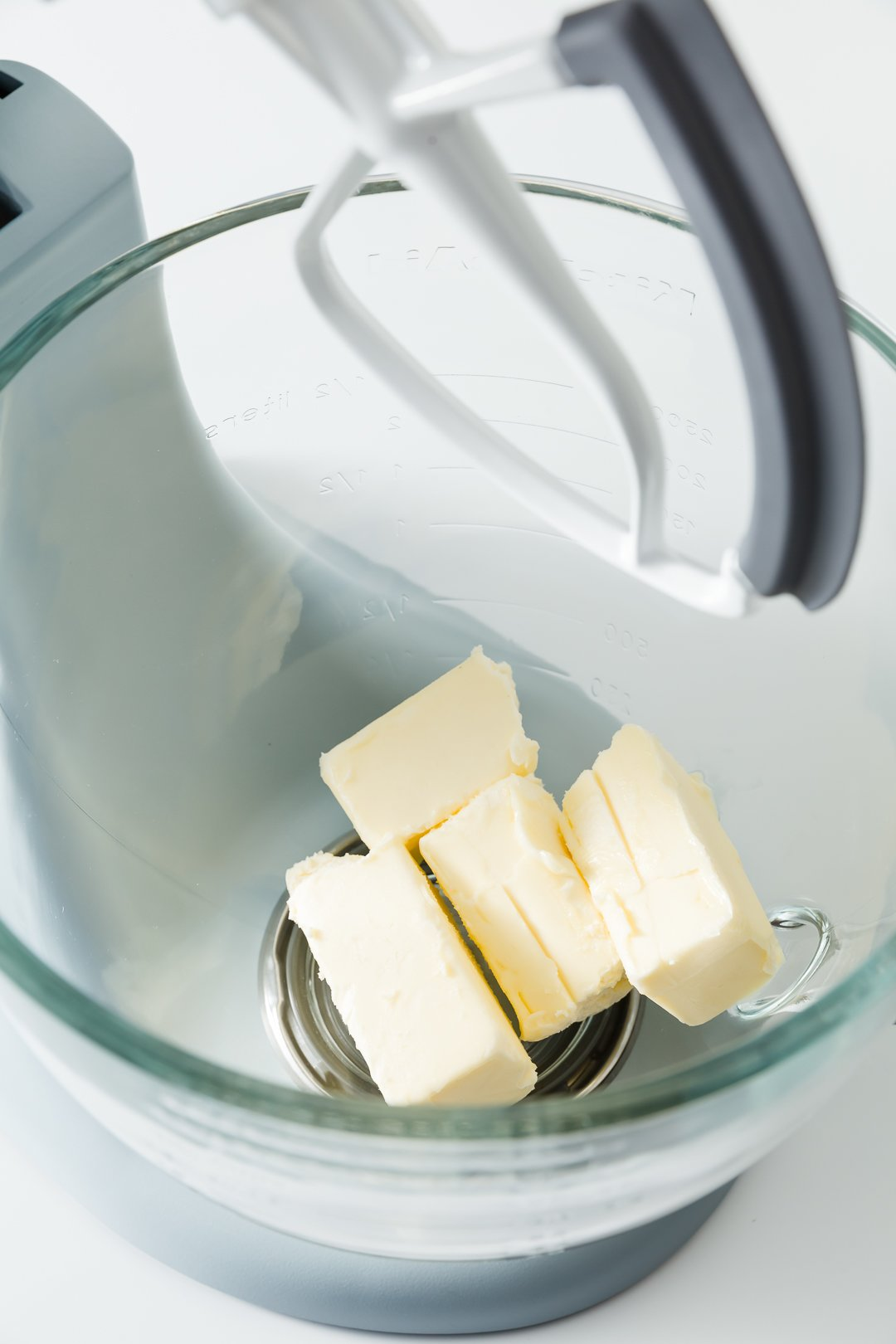 Butter in the bowl of a stand mixer fitted with the paddle attachement