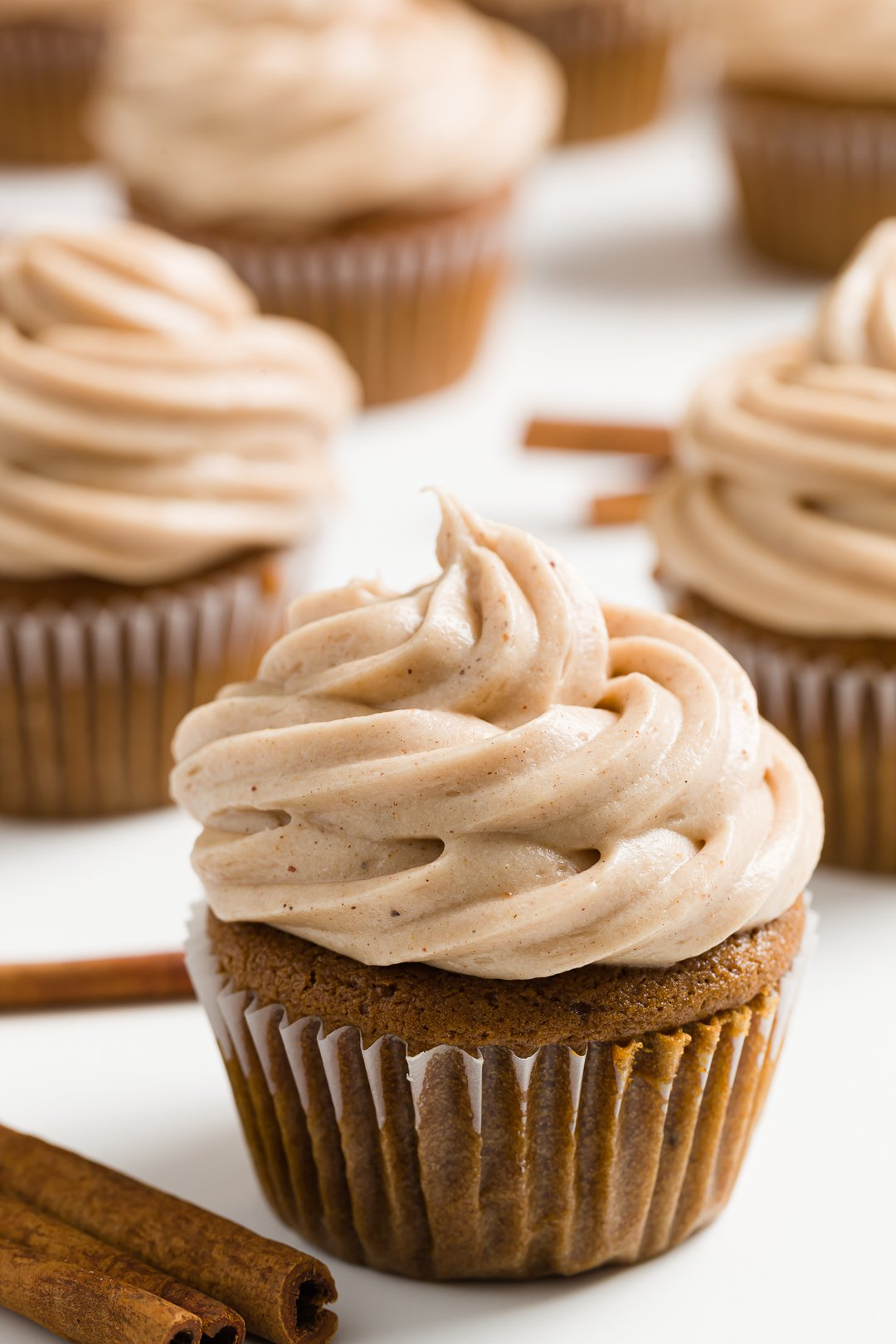 cinnamon cream cheese frosting on a cupcake