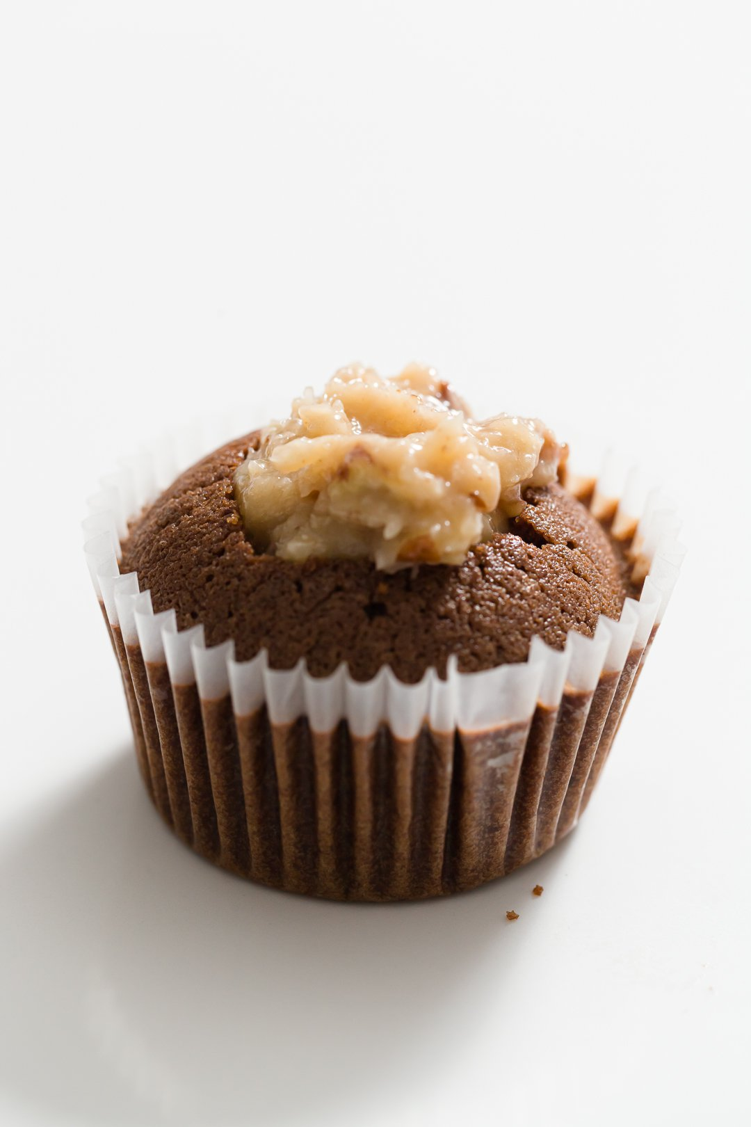 German chocolate cupcake right after being filled