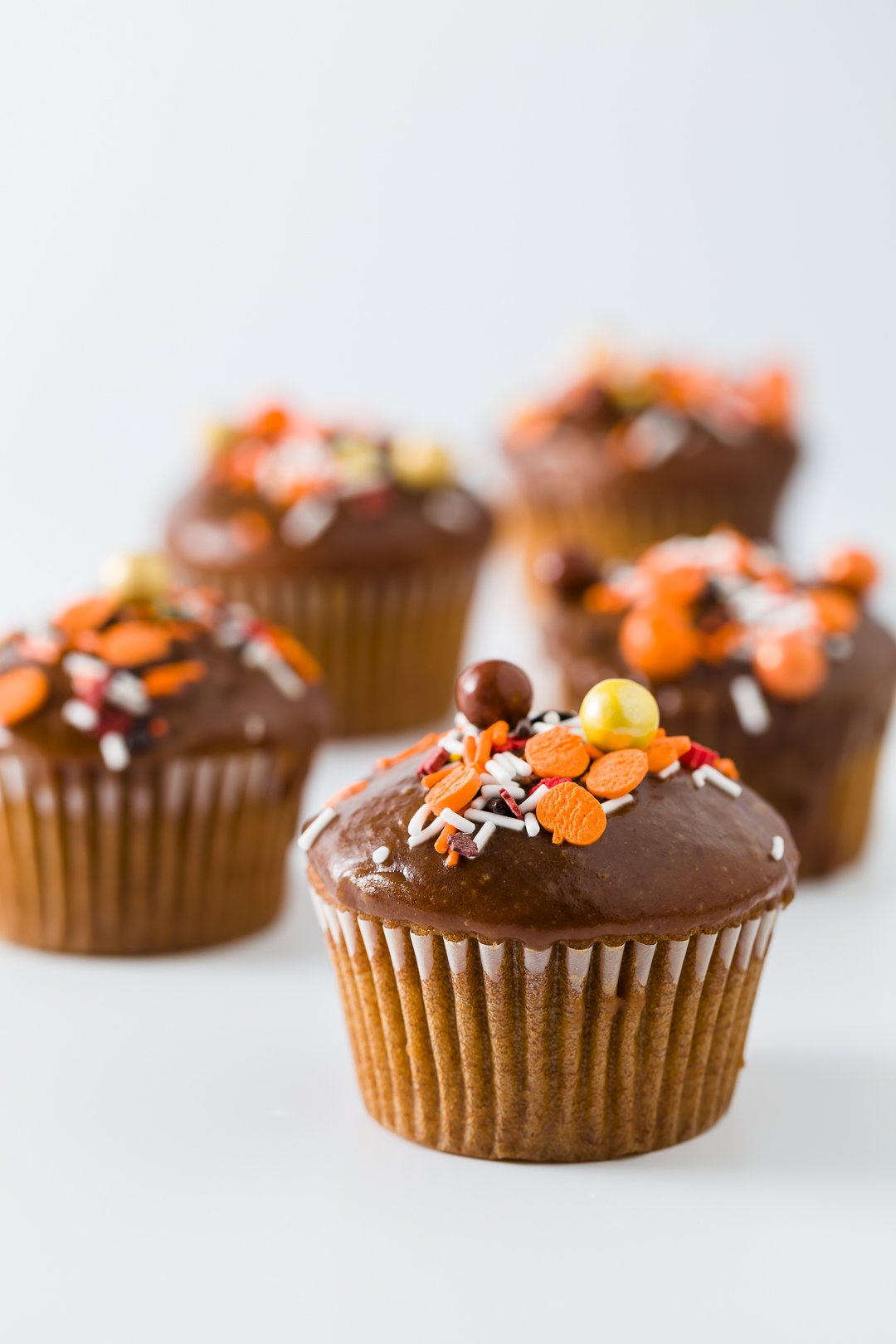 Pumpkin cupcakes frosted with apple butter caramel icing