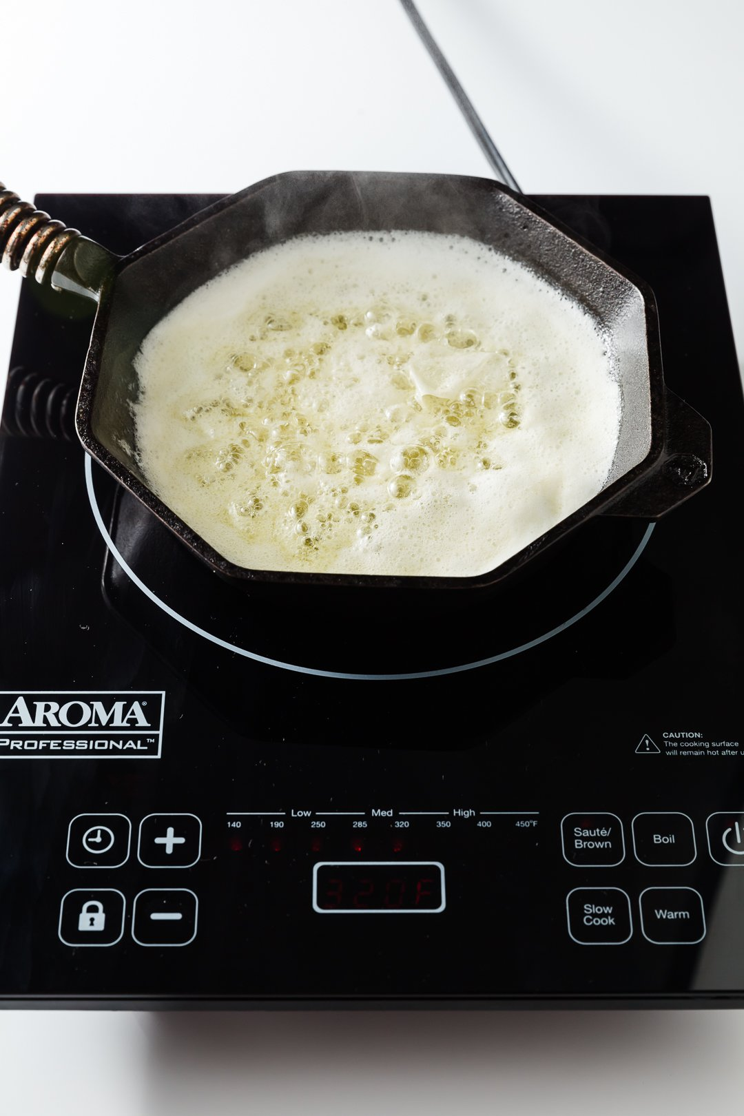 butter boiling in a skillet