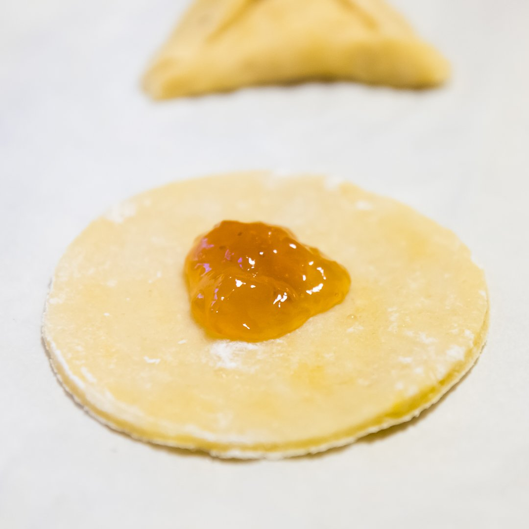 Hamantaschen dough with filling in the center