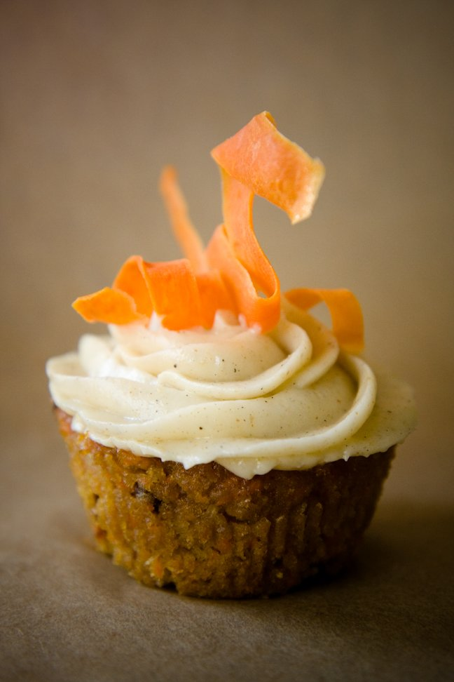 Carrot cake cupcakes topped with candied carrot curls
