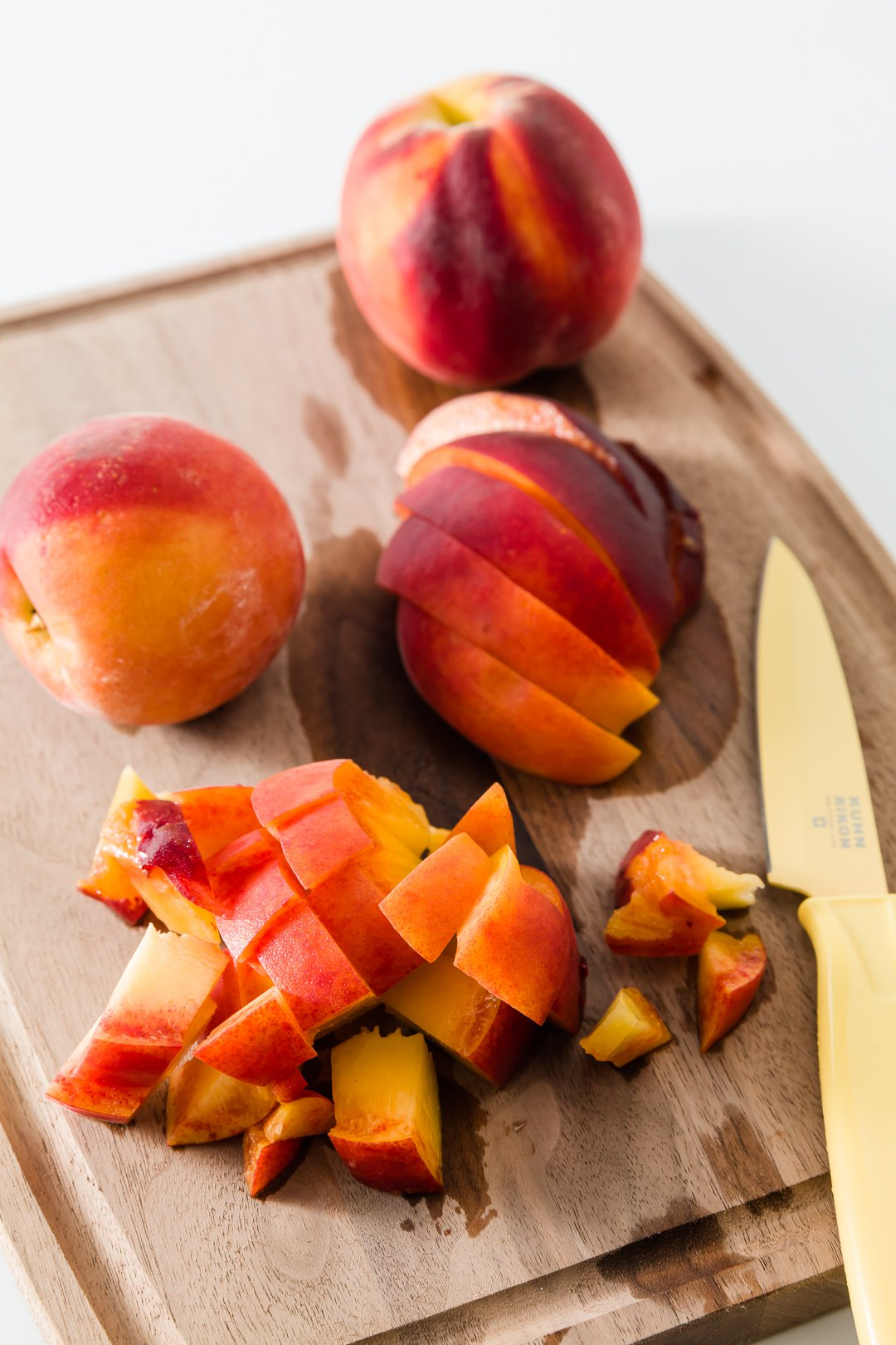 Chopped peaches on a cutting board