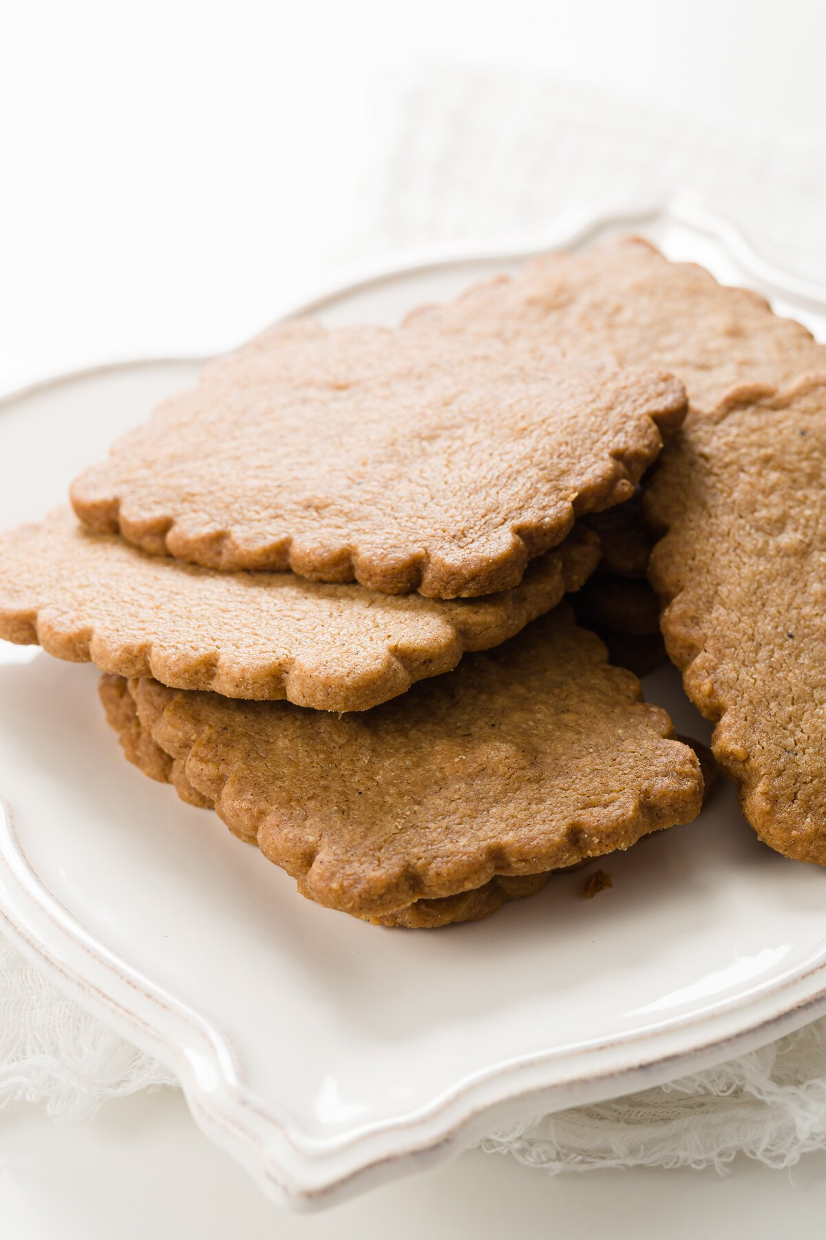 White plate of speculoos cookies in a pile
