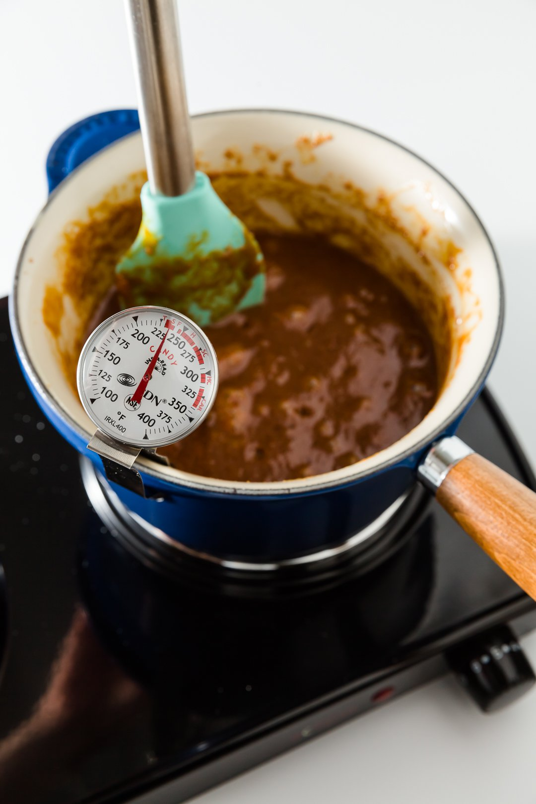 Caramel frosting cooking in a saucepan