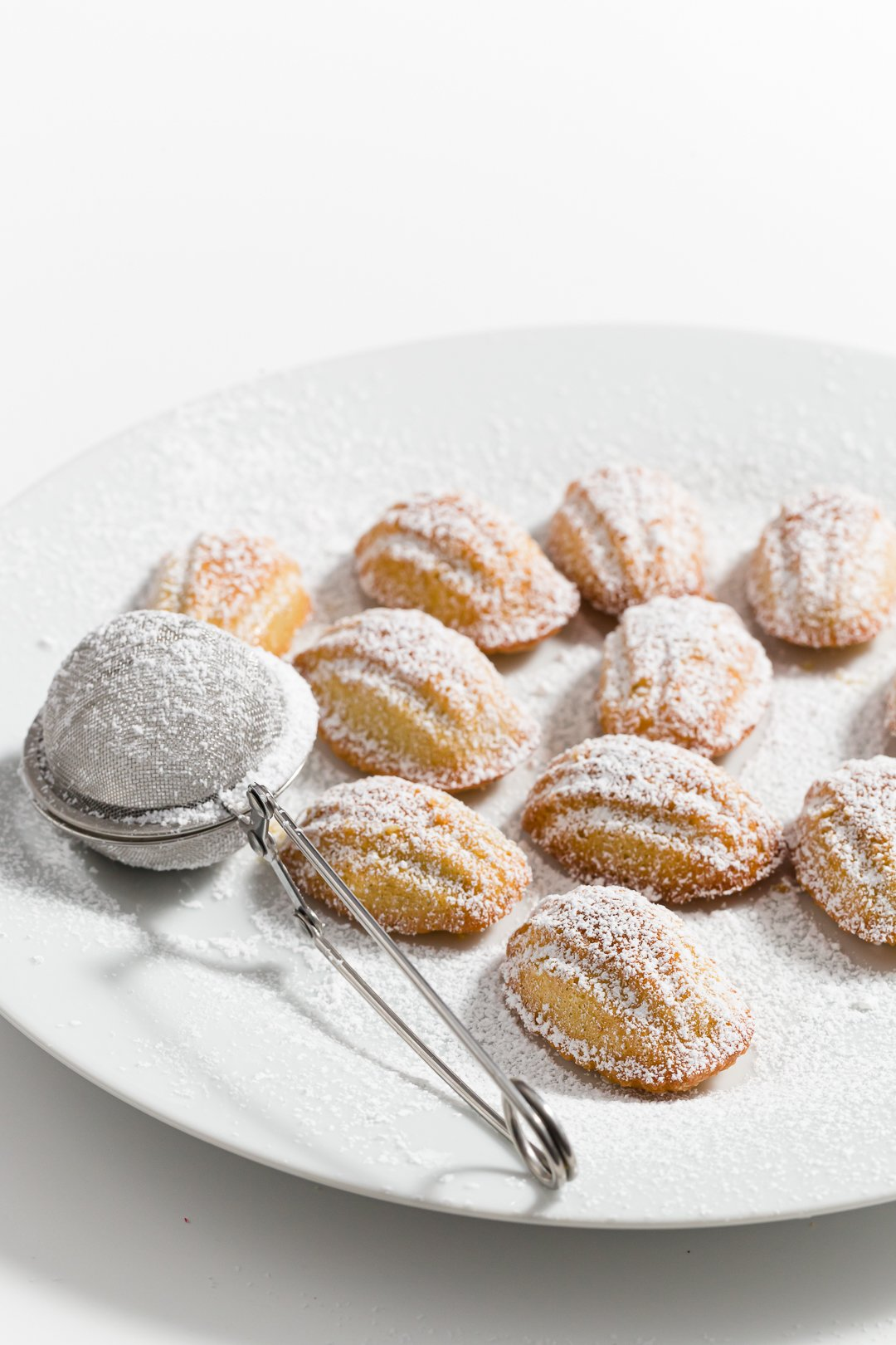 Mini madeleines dusted in powdered sugar