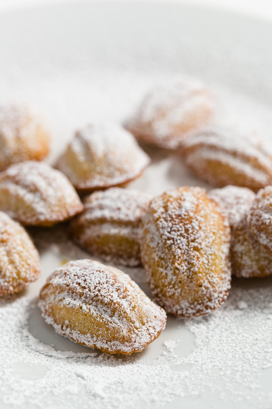 Mini Madeleines dusted with powdered sugar