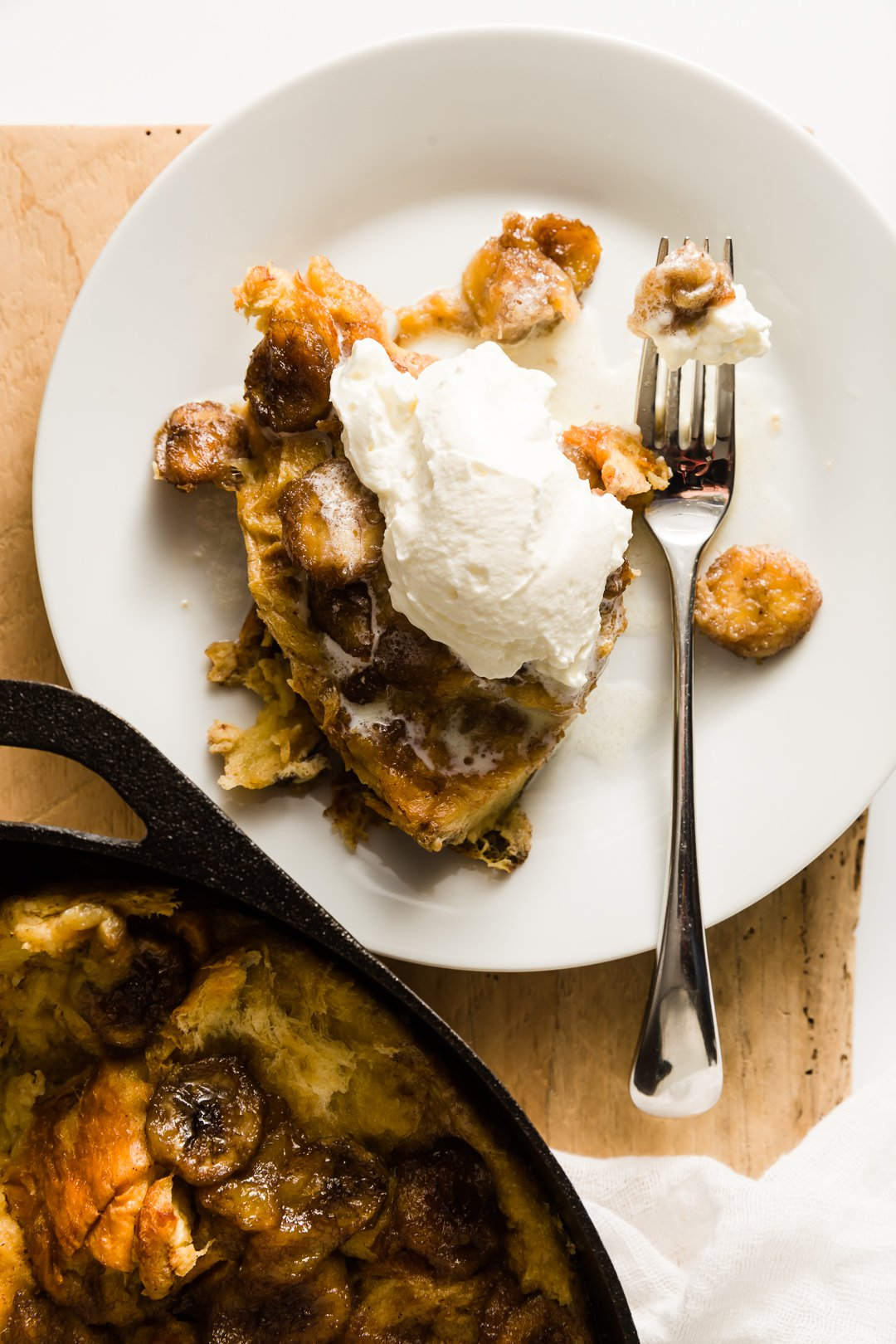 bananas foster french toast on plate with some whipped cream