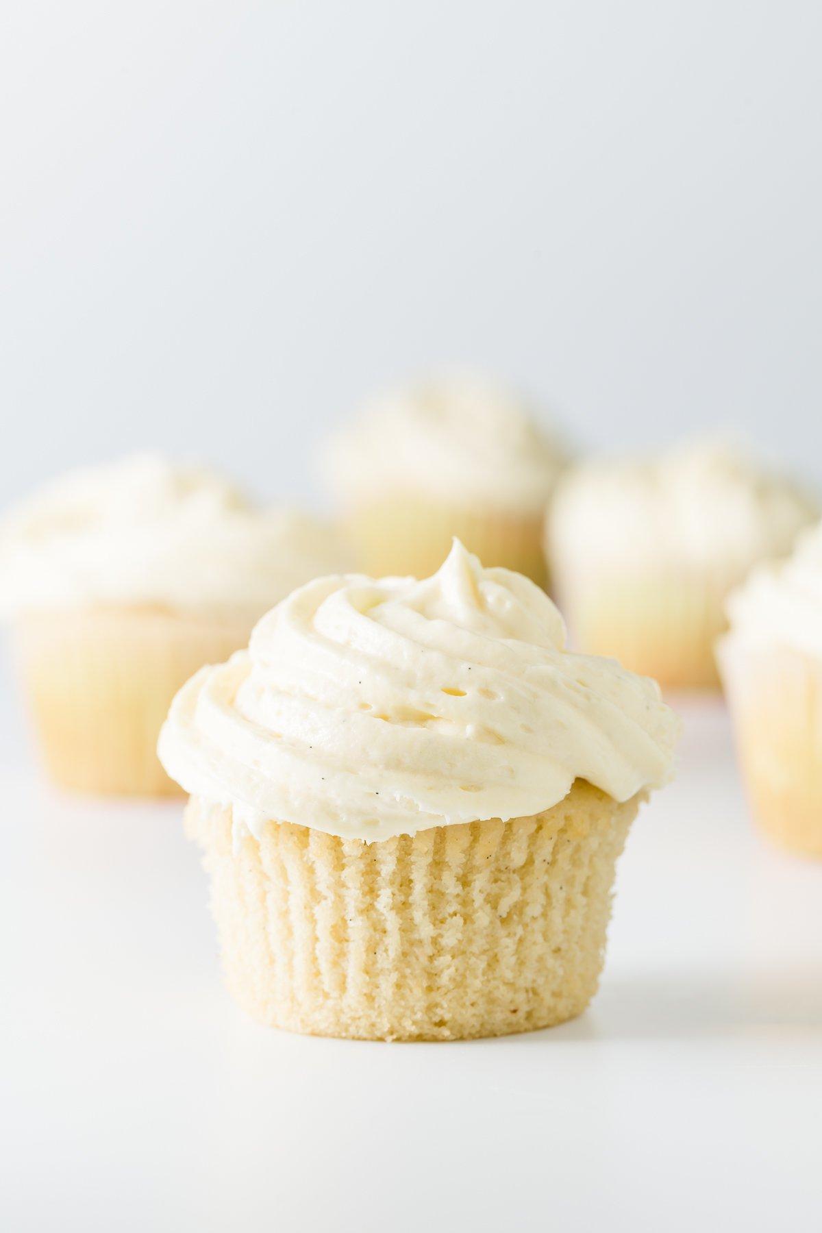 Vanilla frosting on vanilla cupcakes