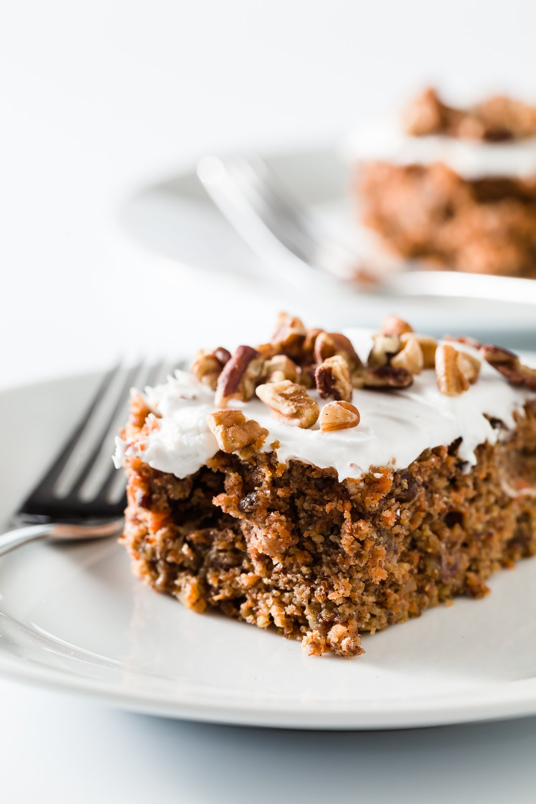 Slice of healthy carrot cake on a plate
