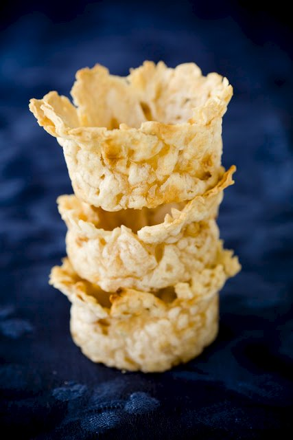 three cups made from matzoh brei stacked on top of each other