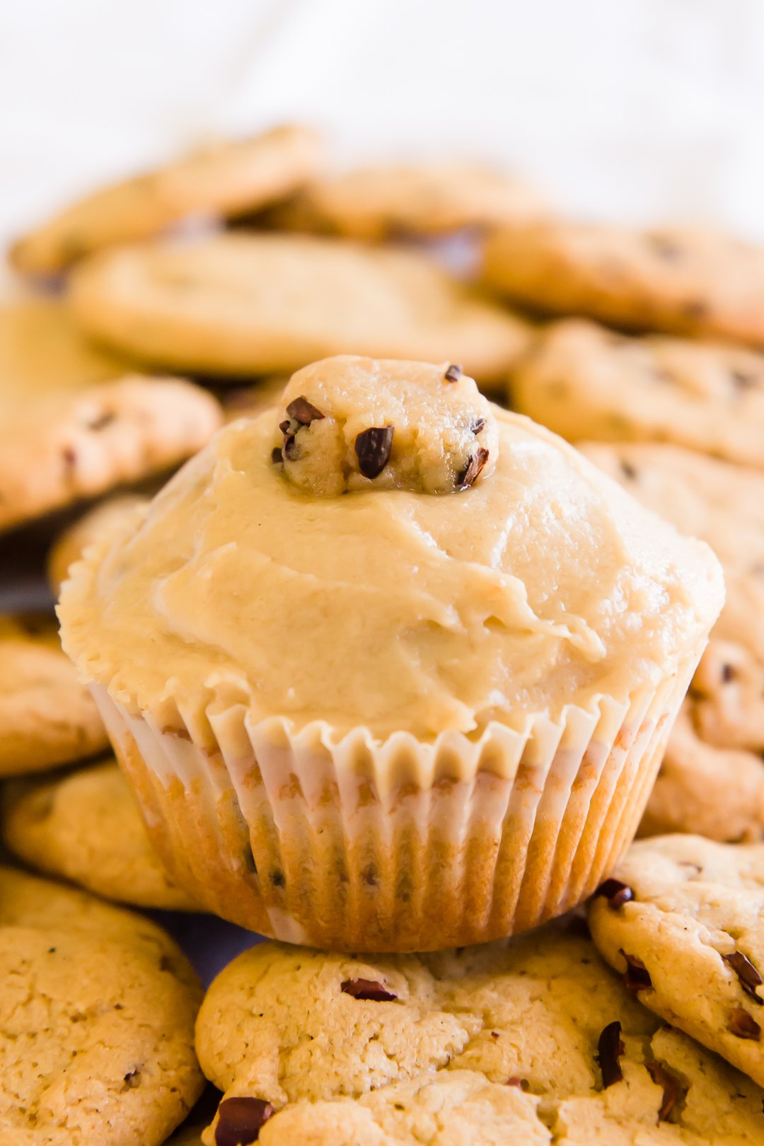 Cookie dough cupcakes on a pile of cookies