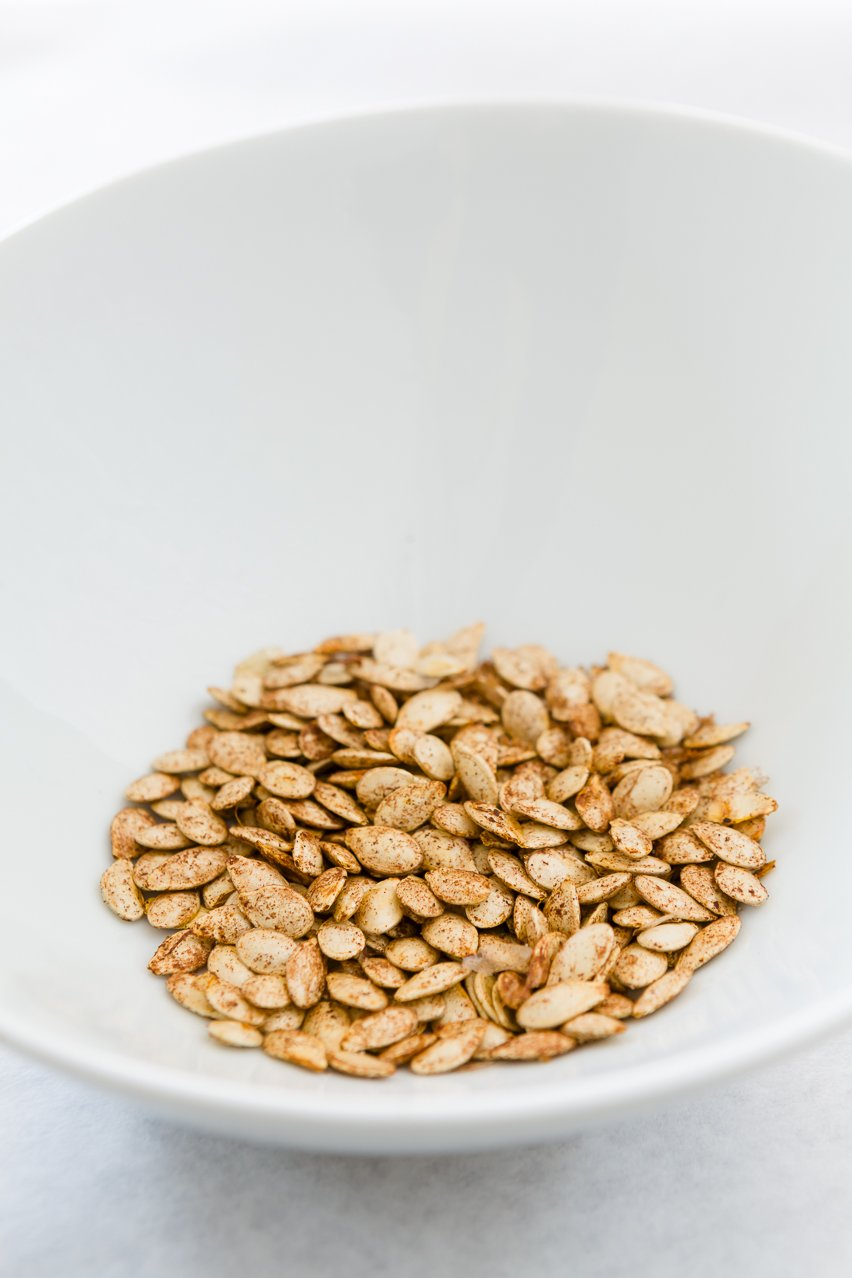 Toasted Pumpkin Seeds in a white bowl