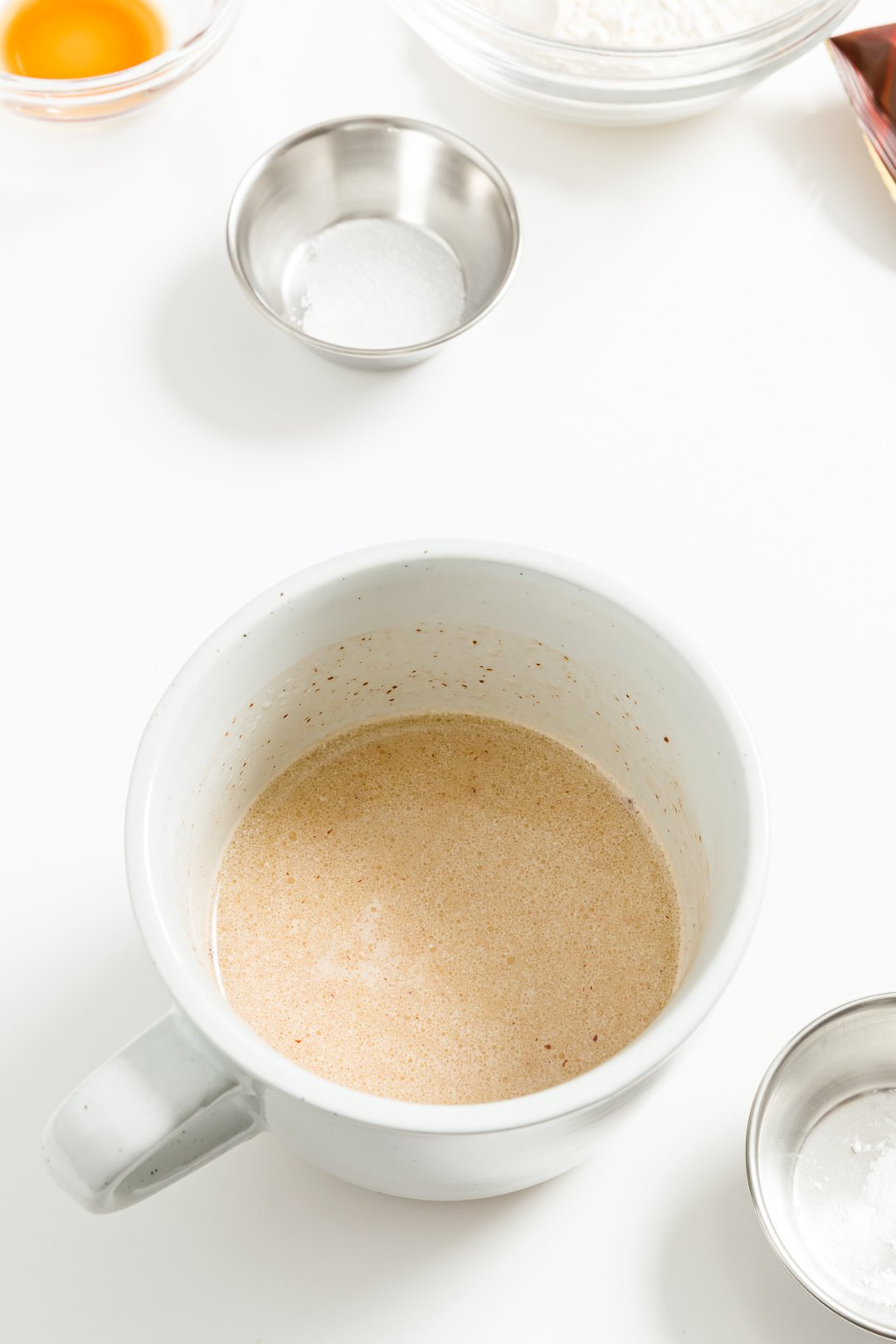 Melted butter, milk, and chocolate in a mug