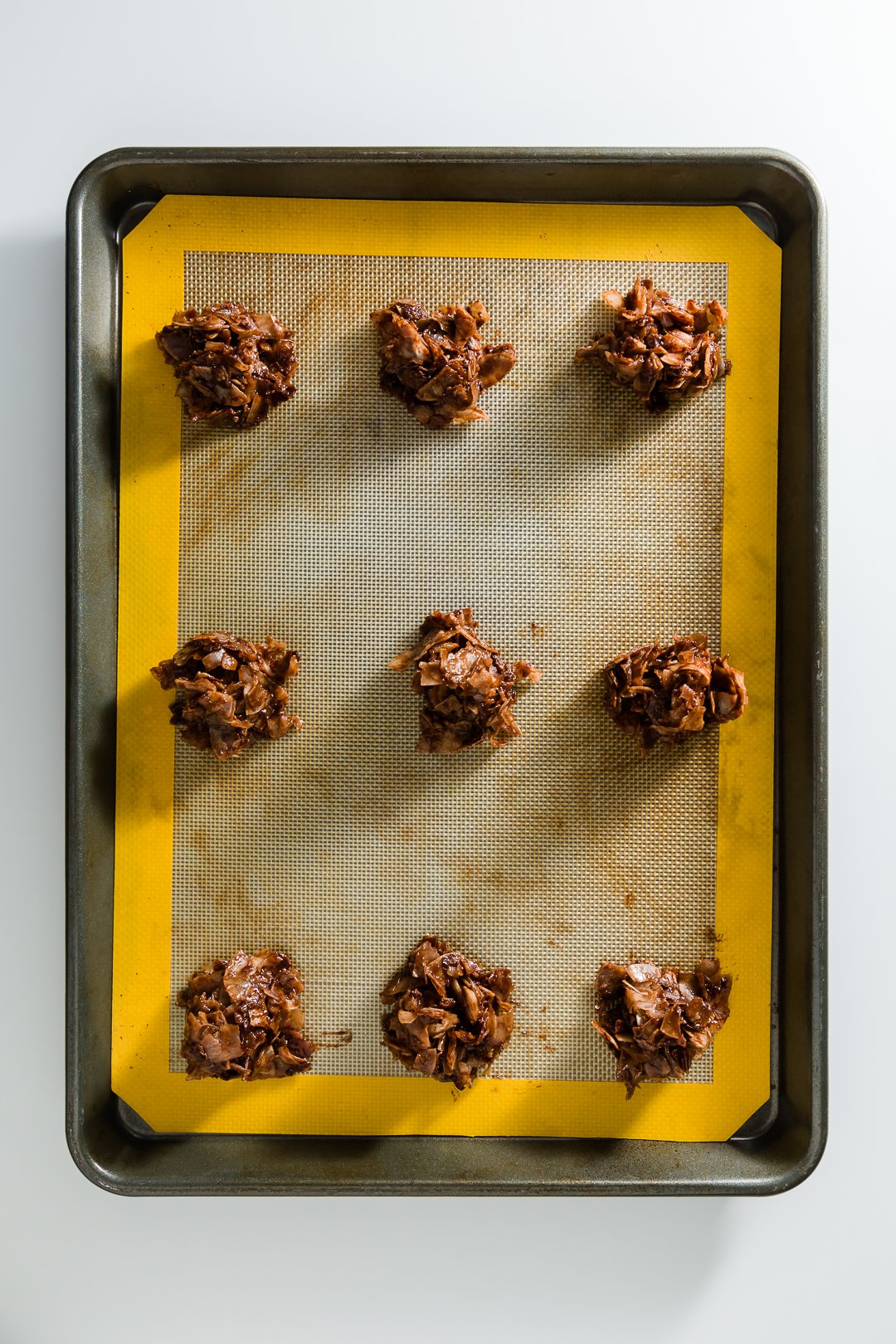 a tray of chocolate macaroons ready to go into the oven