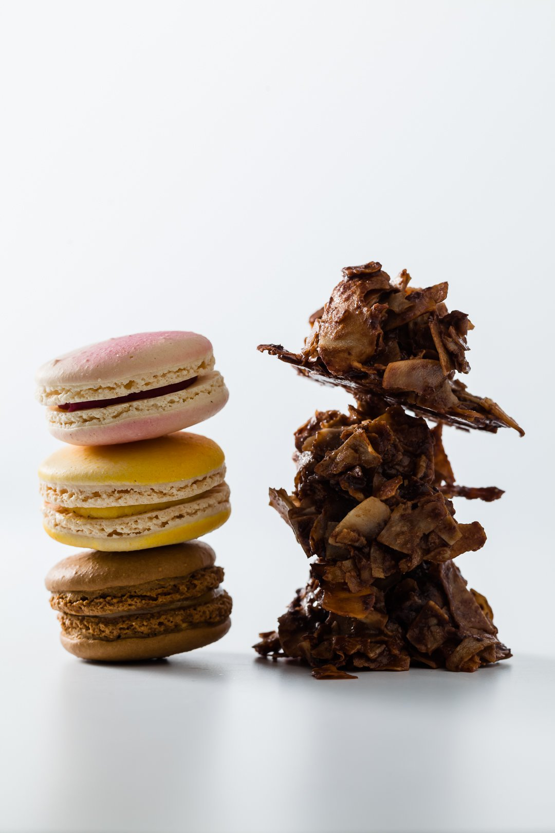 A stack of macaroons next to a stack of macaroons