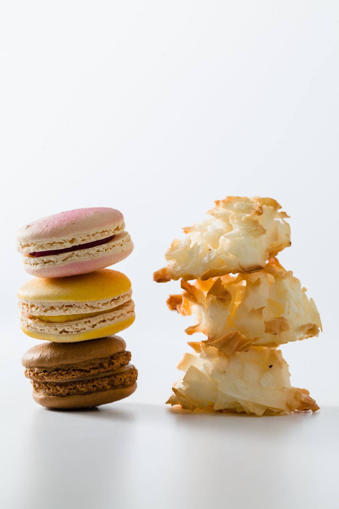 A stack of macarons and a stack of macaroons