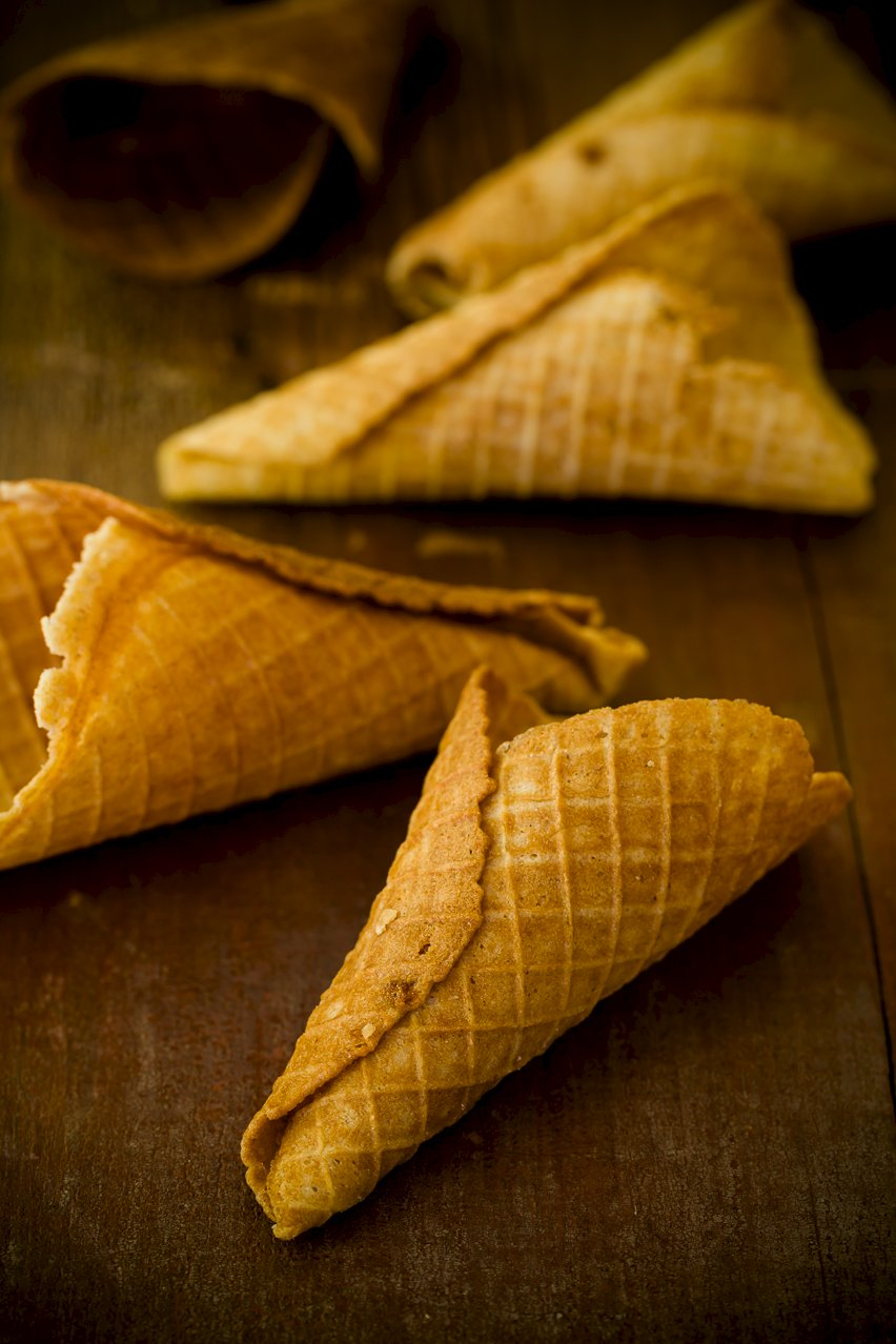 Several Waffle Cones on wood