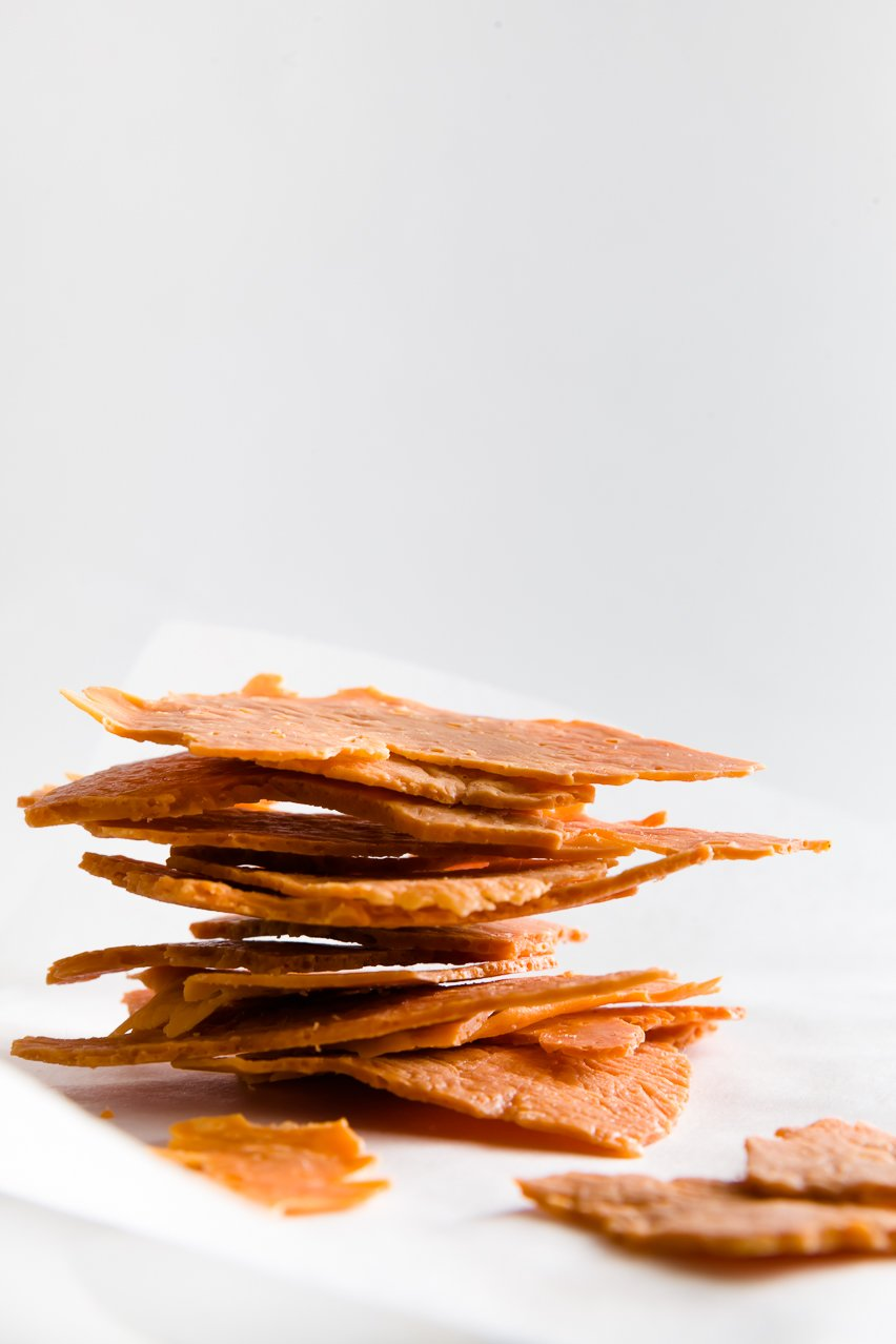 A stack of cheddar crisps