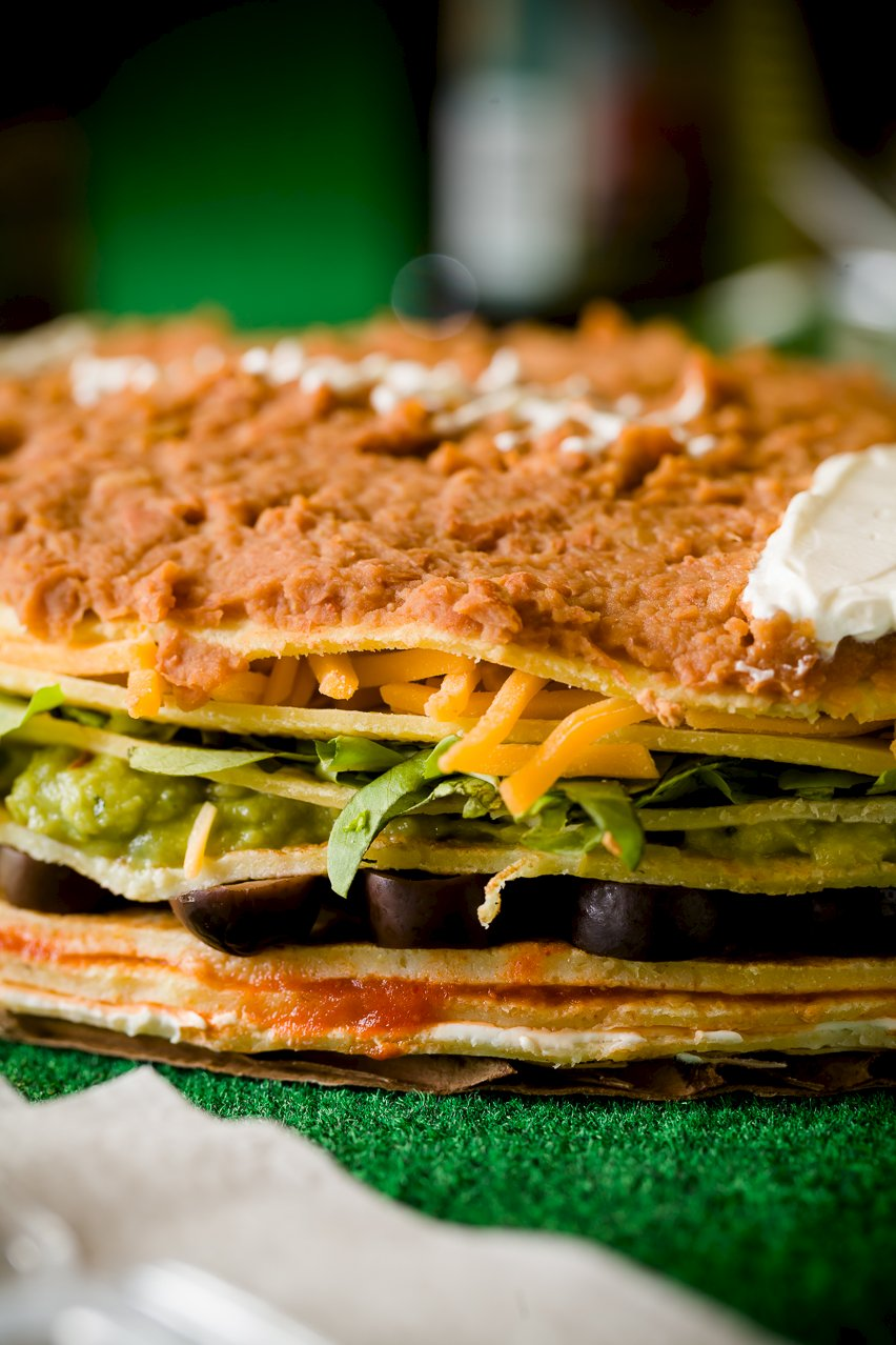 Close-up view of the layers of 7 layer dip crepe cake