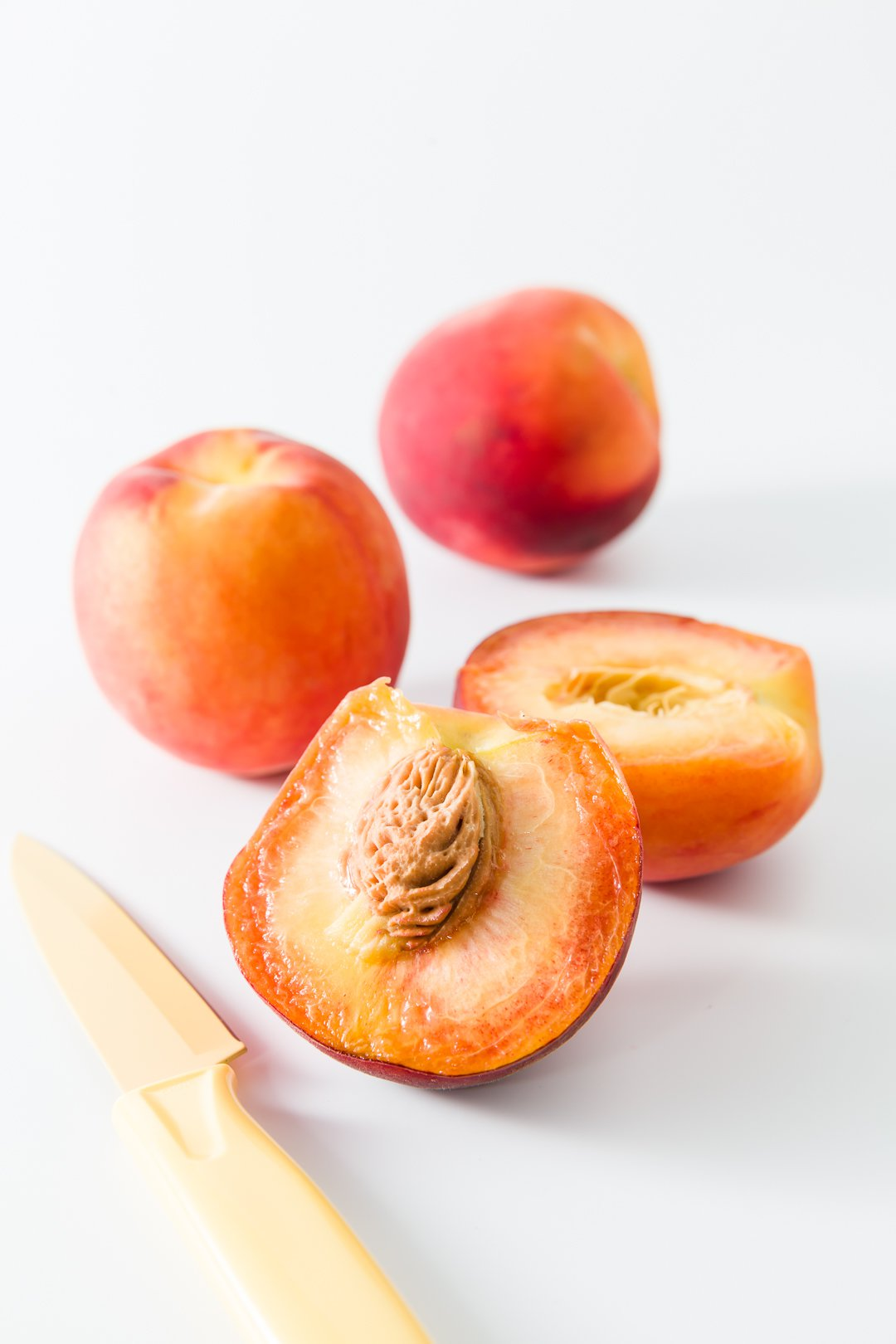 Peaches sliced in half