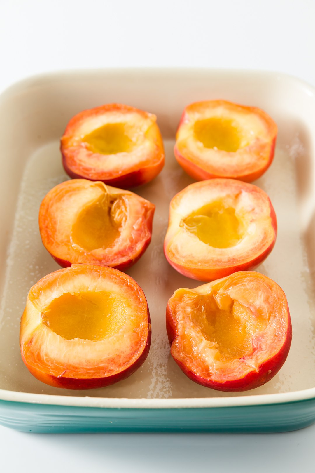 Sliced peaches in a baking dish