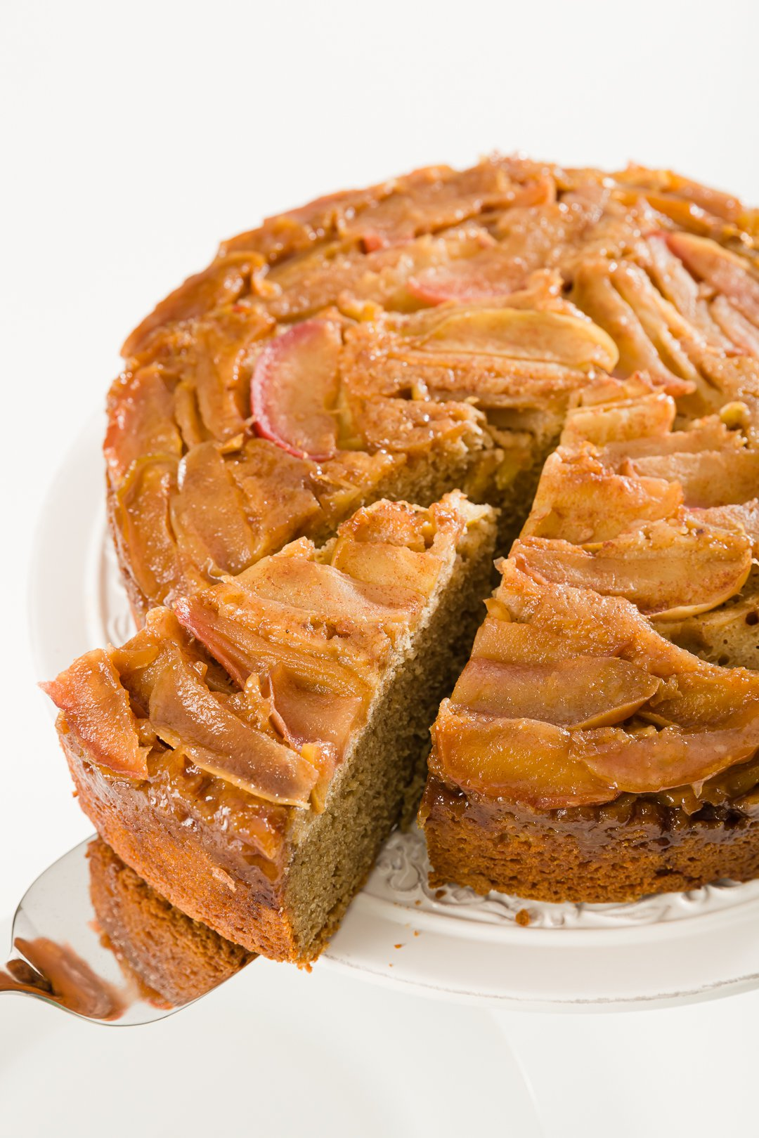 Apple upside-down cake with a slice pulled out