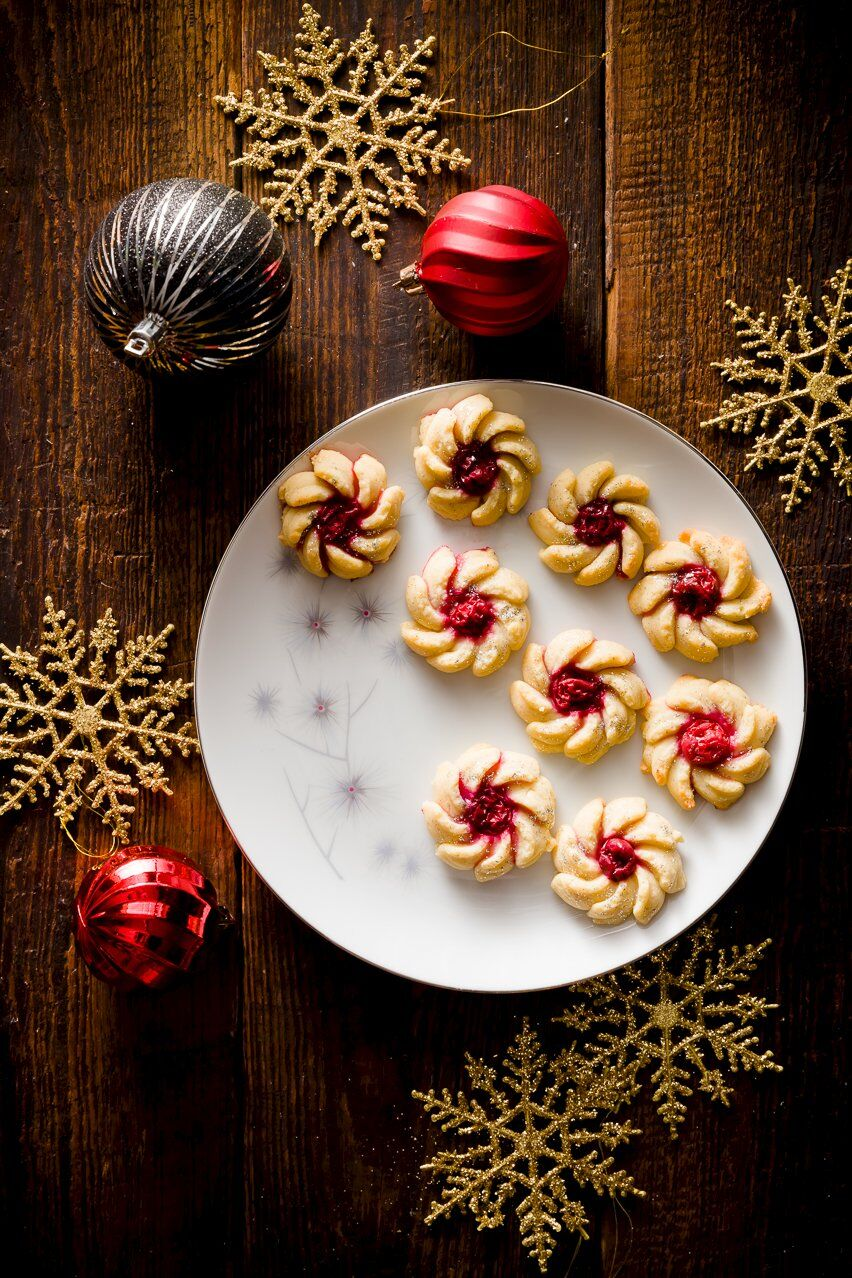 Spritz Cookies on a plate decorated for Christmas
