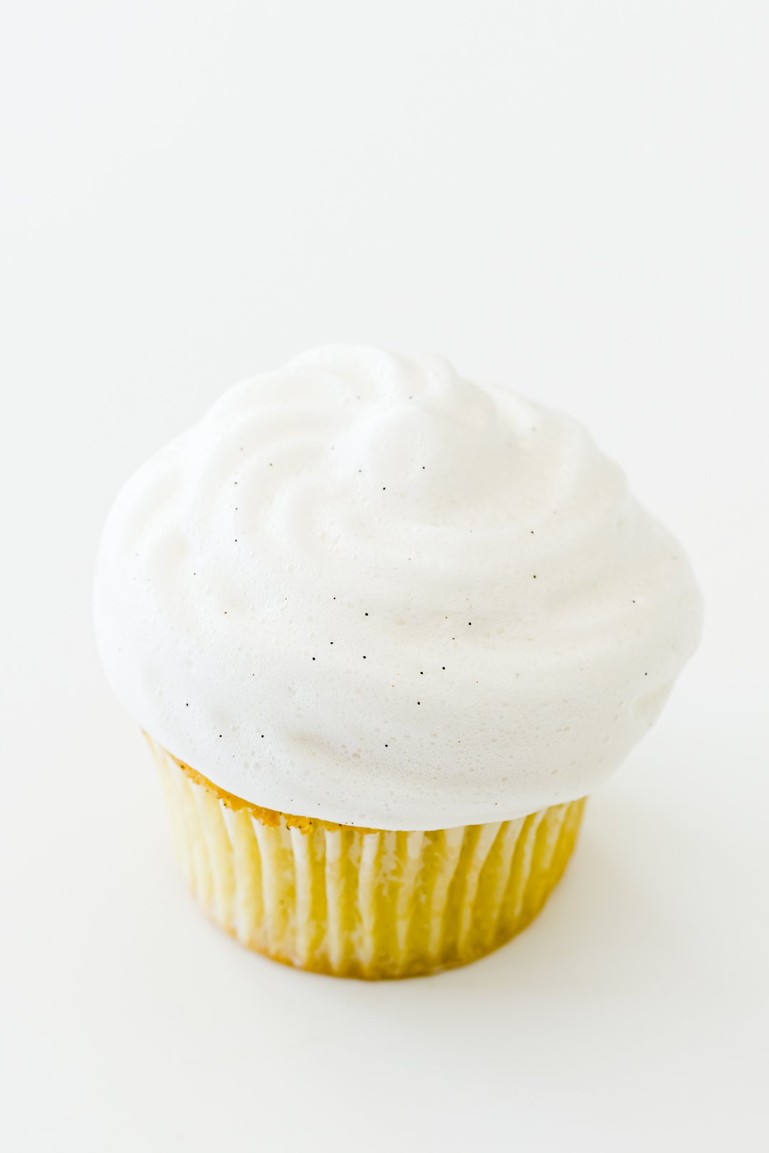 Aquafaba meringue on a cupcake without torching
