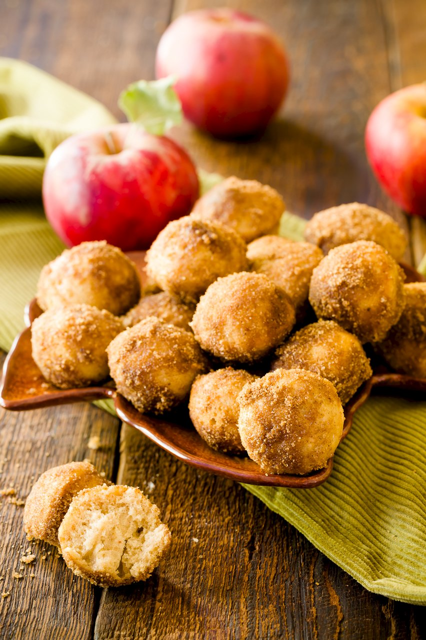 Apple Cider Donuts with apples in the background