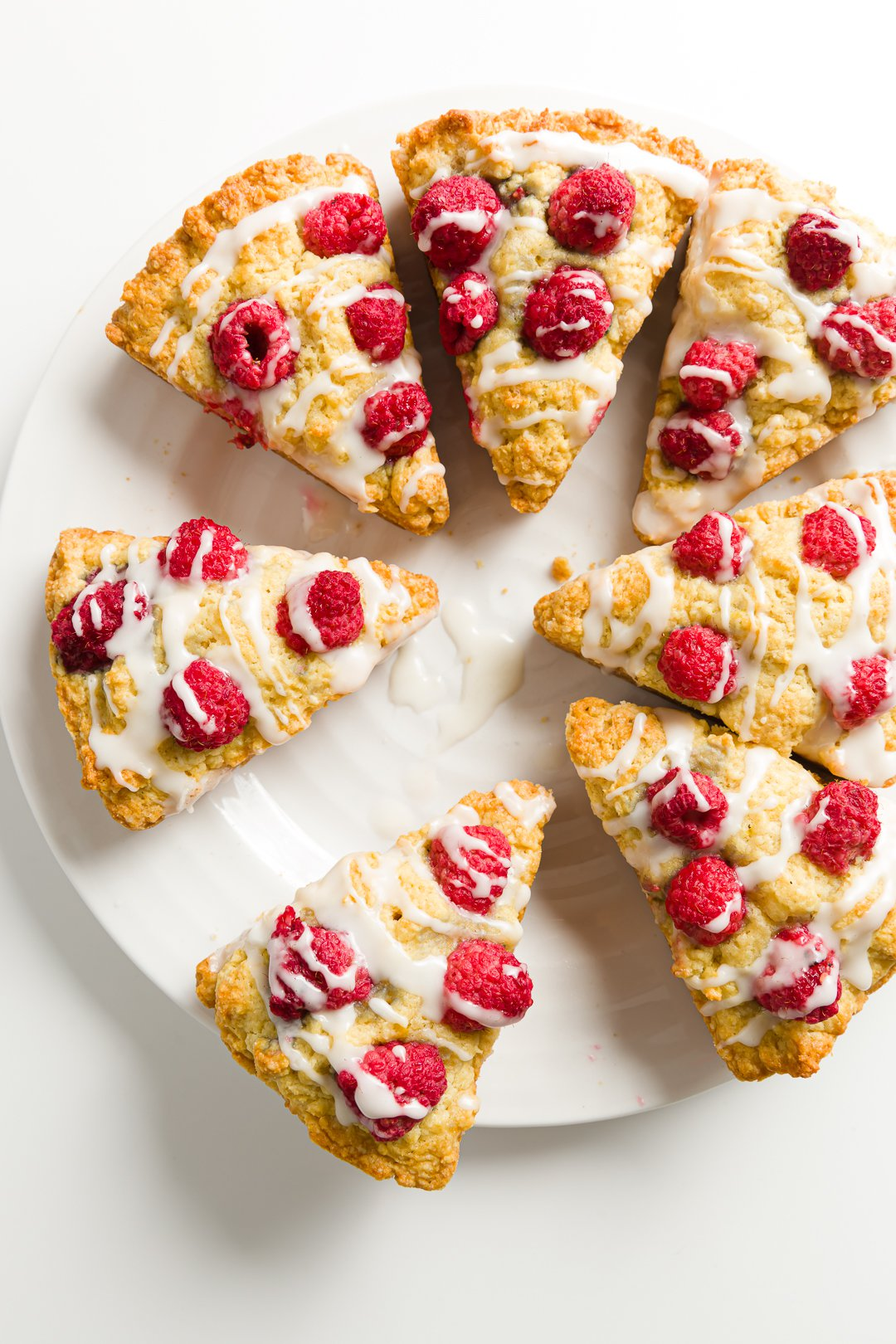 A plate filled with raspberry scones