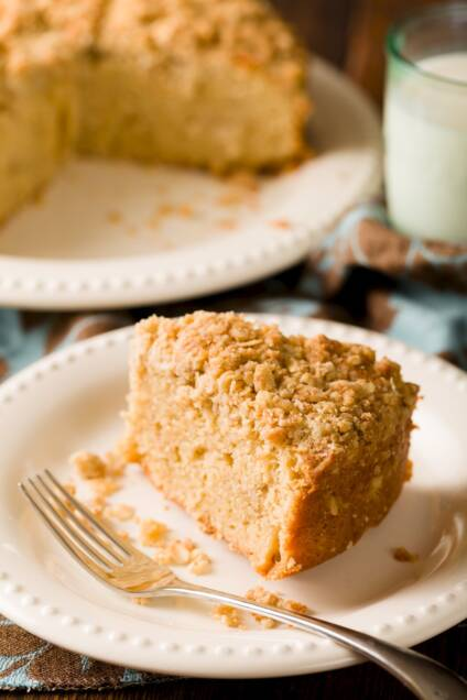 A slice of crumb cake with a fork