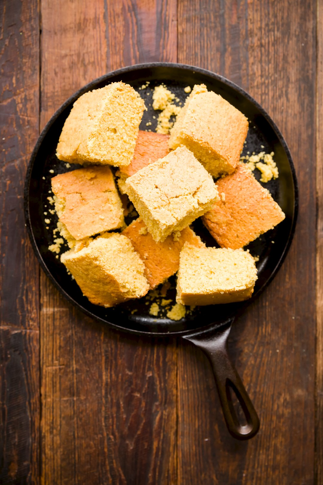Cornbread pieces in a cast iron skillet