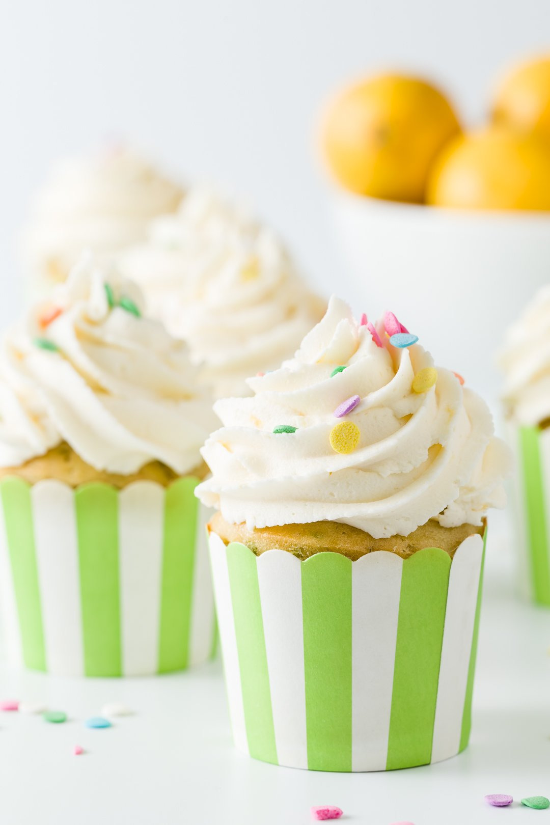 Cupcakes with sprinkles in green striped wrappers