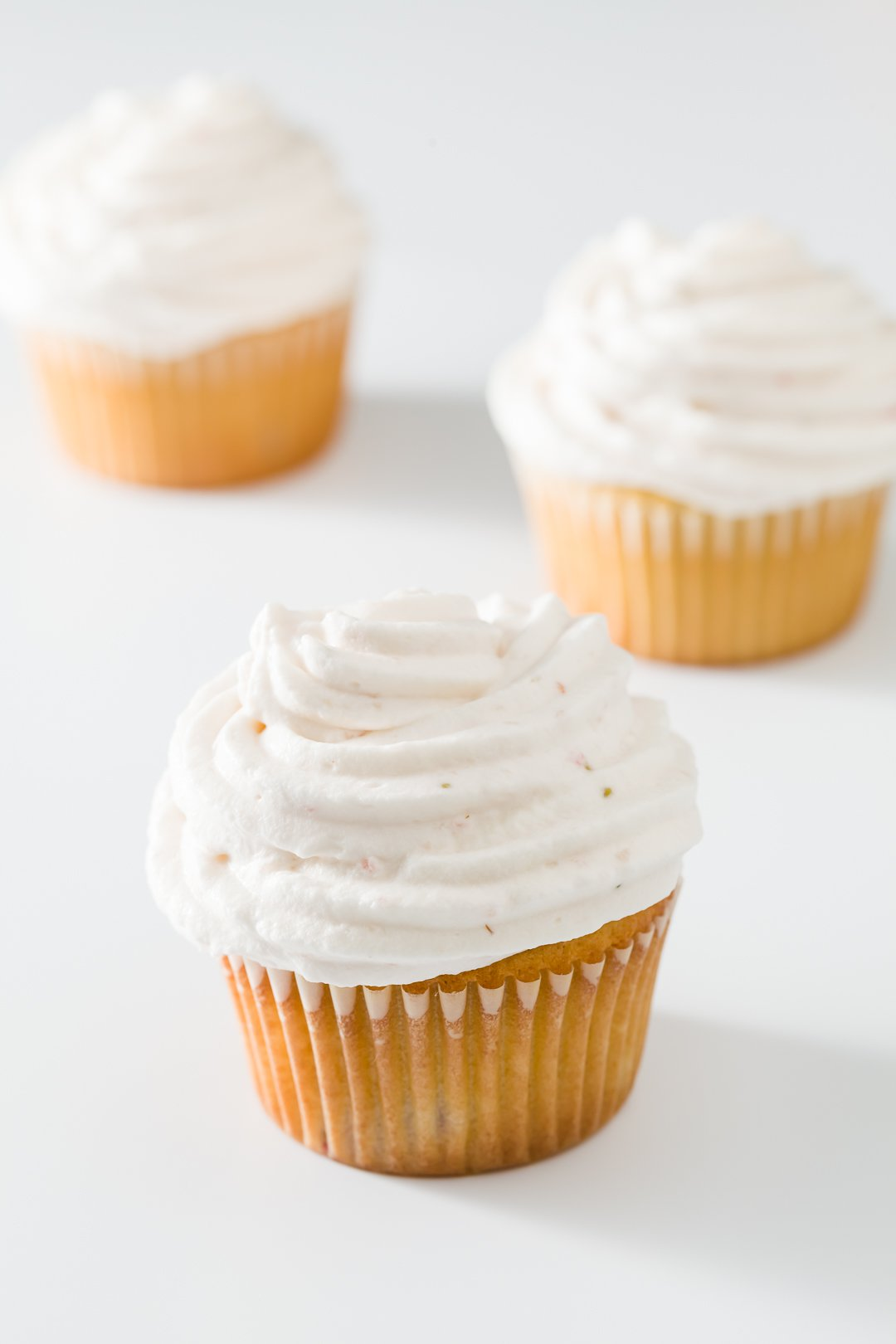 Vanilla Cupcakes with Strawberry Whipped Cream Frosting