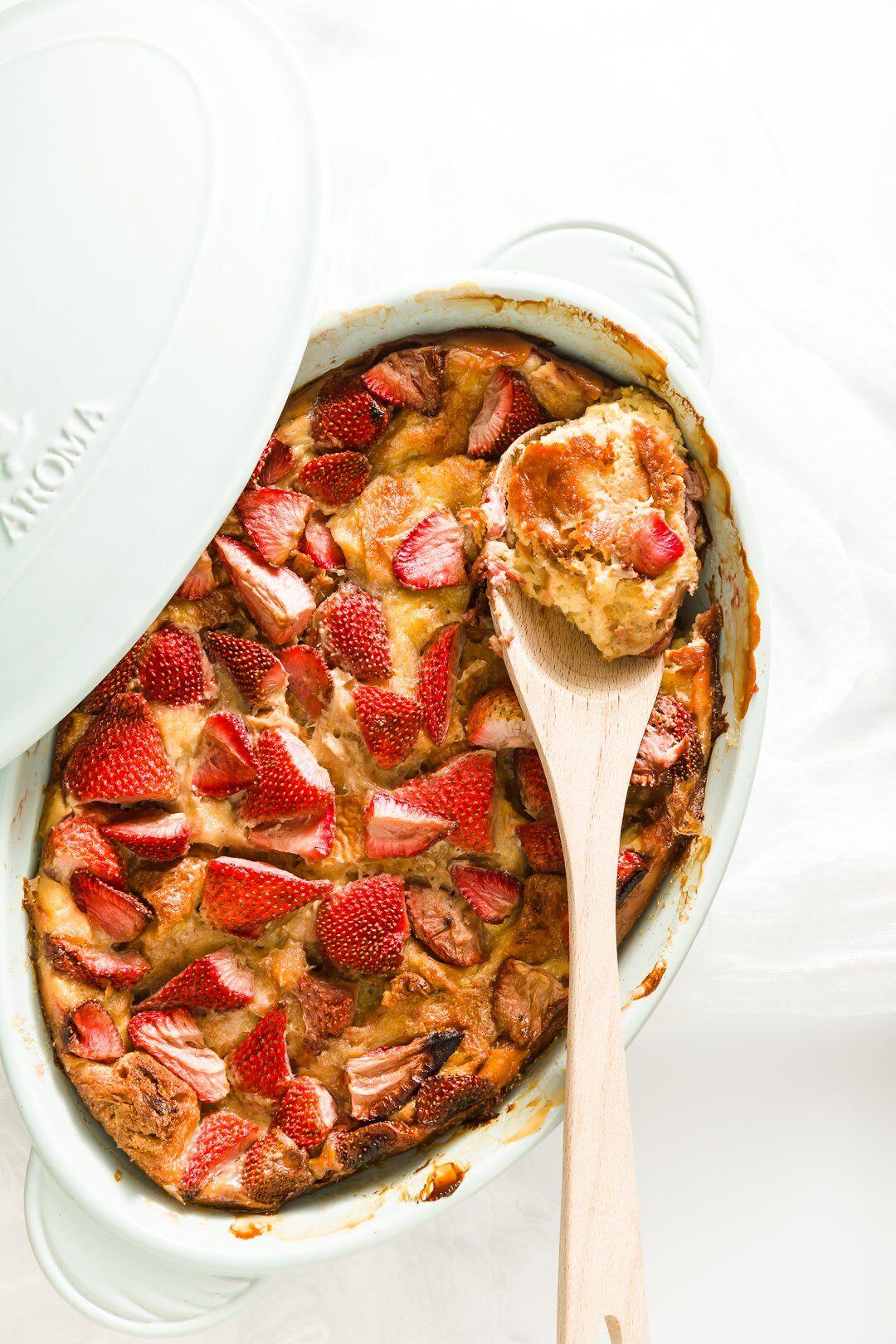 Strawberry brioche French toast in a casserole dish