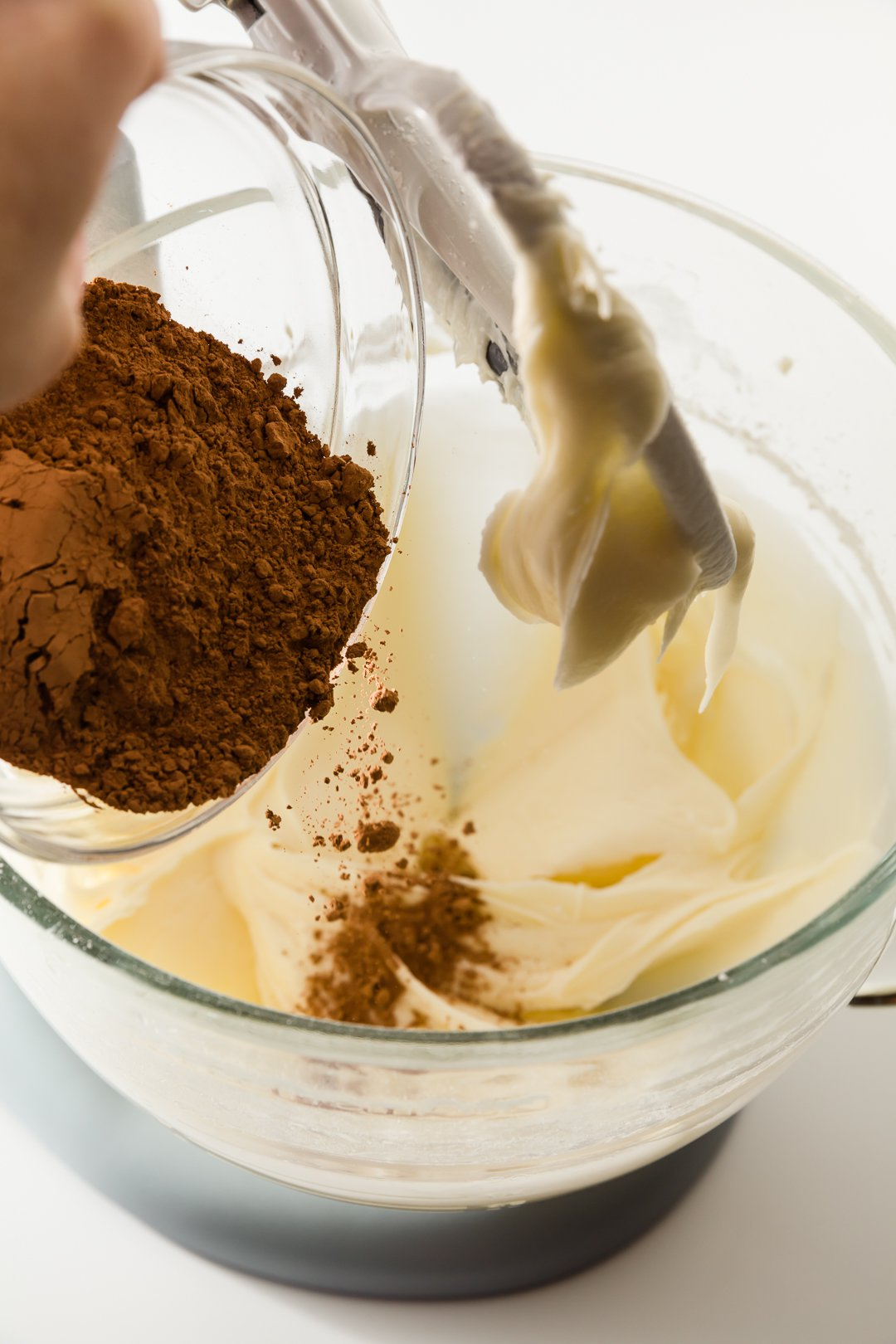 Adding cocoa powder to chocolate cream cheese frosting