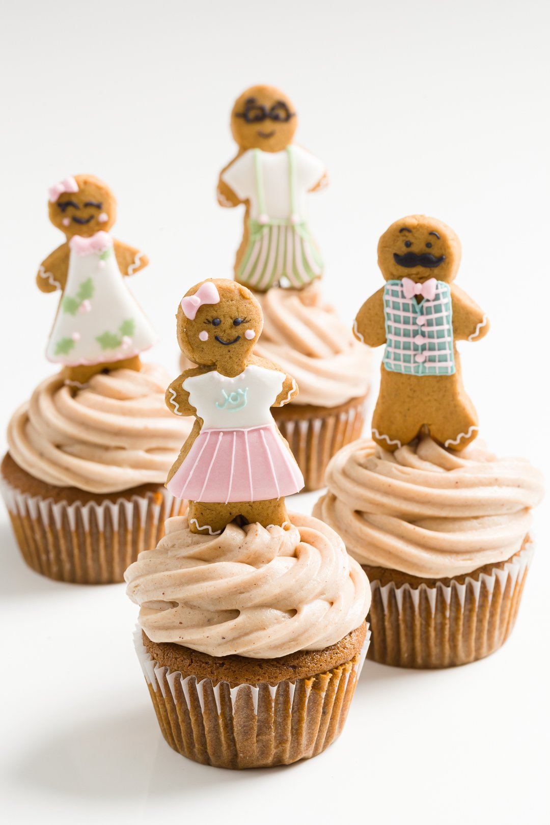 a group of gingerbread cupcakes
