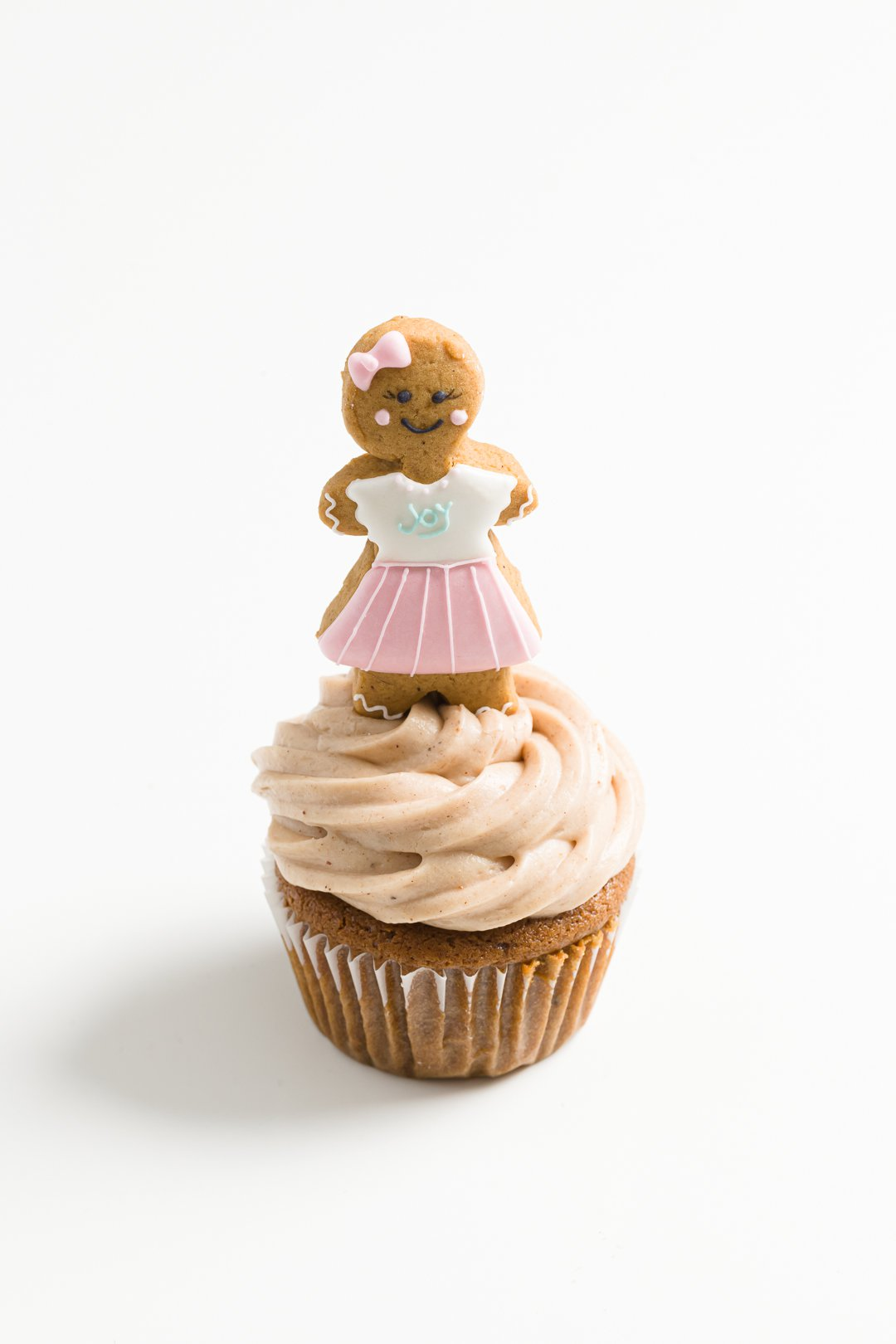 a gingerbread cupcake with a gingerbread man on top