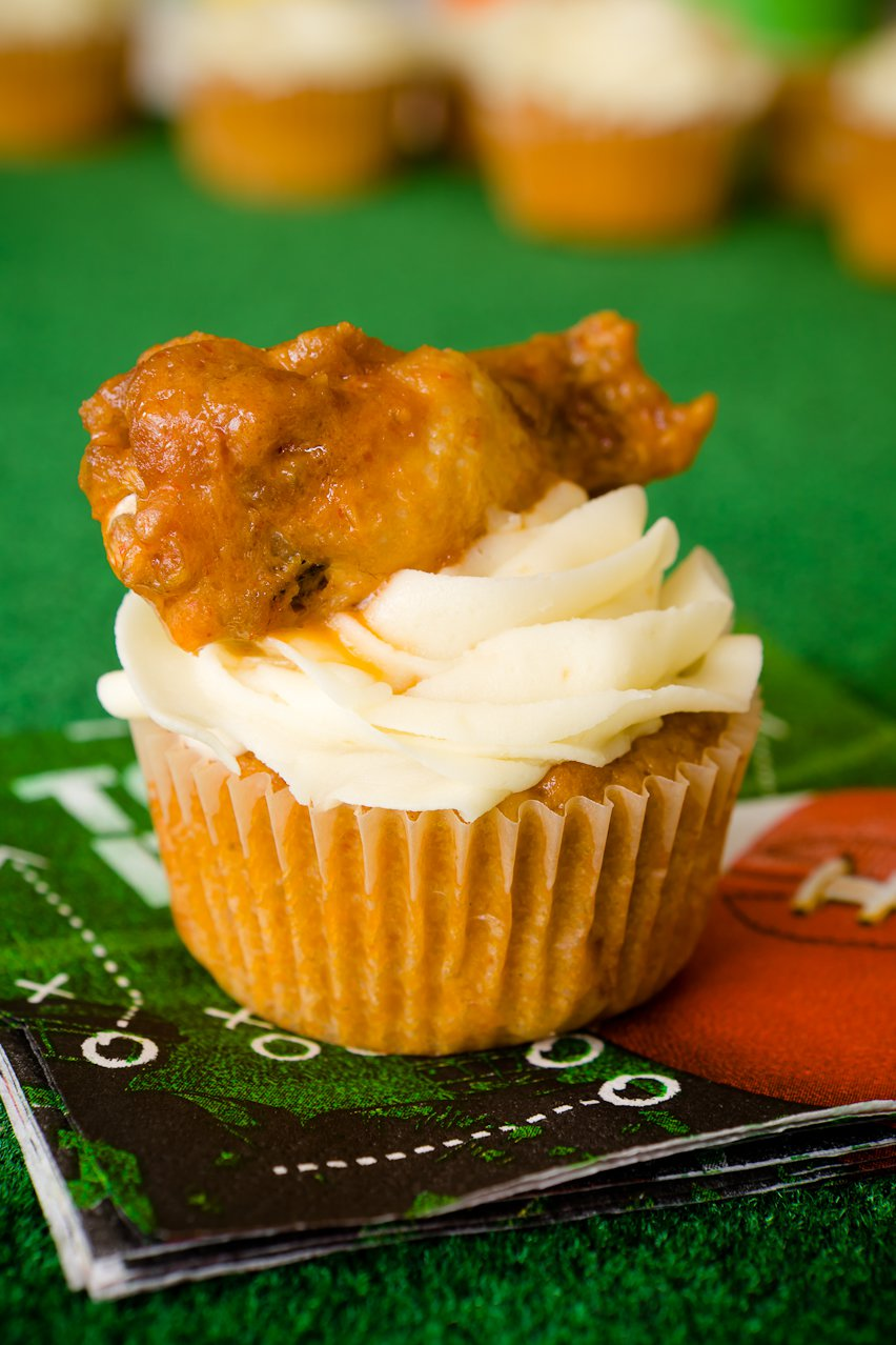 Buffalo chicken cupcake on a Super Bowl napkin with a buffalo chicken wing on top