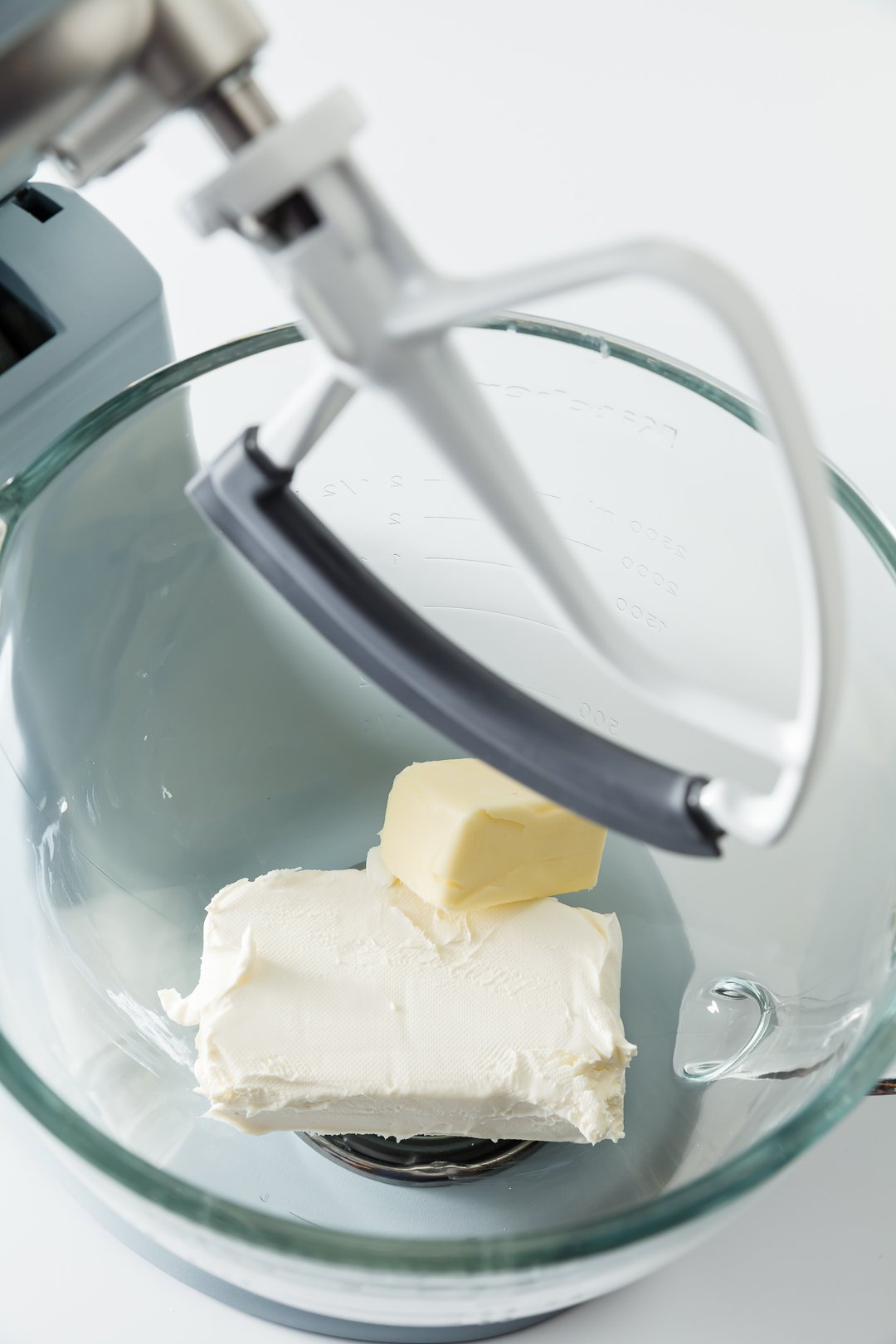 butter and cream cheese in a stand mixer bowl