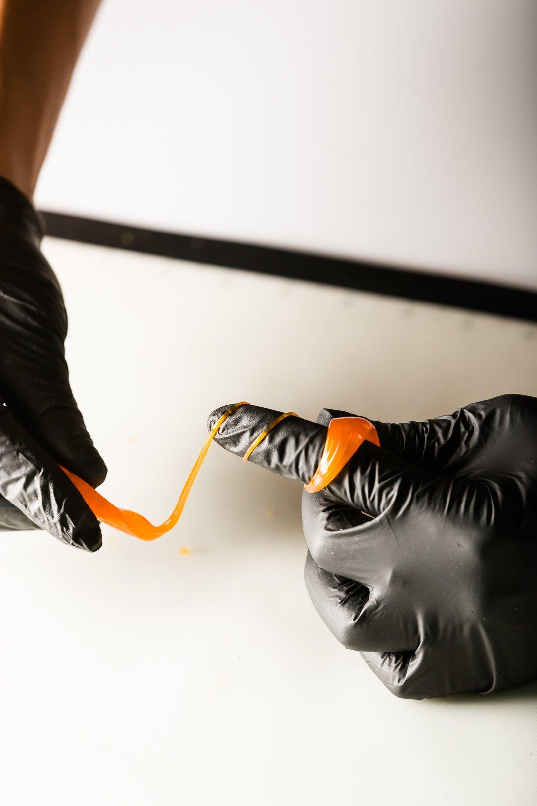 winding isomalt around a finger