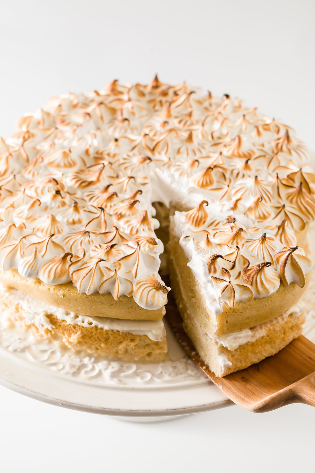 Pressure cooker tres leches cake with a slice on a cake server