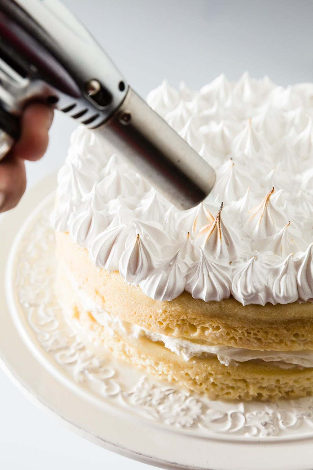 Using a culinary torch to toast meringue frosting