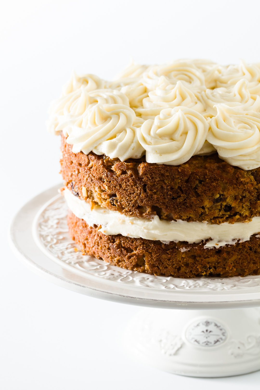 carrot cake topped with cream cheese frosting