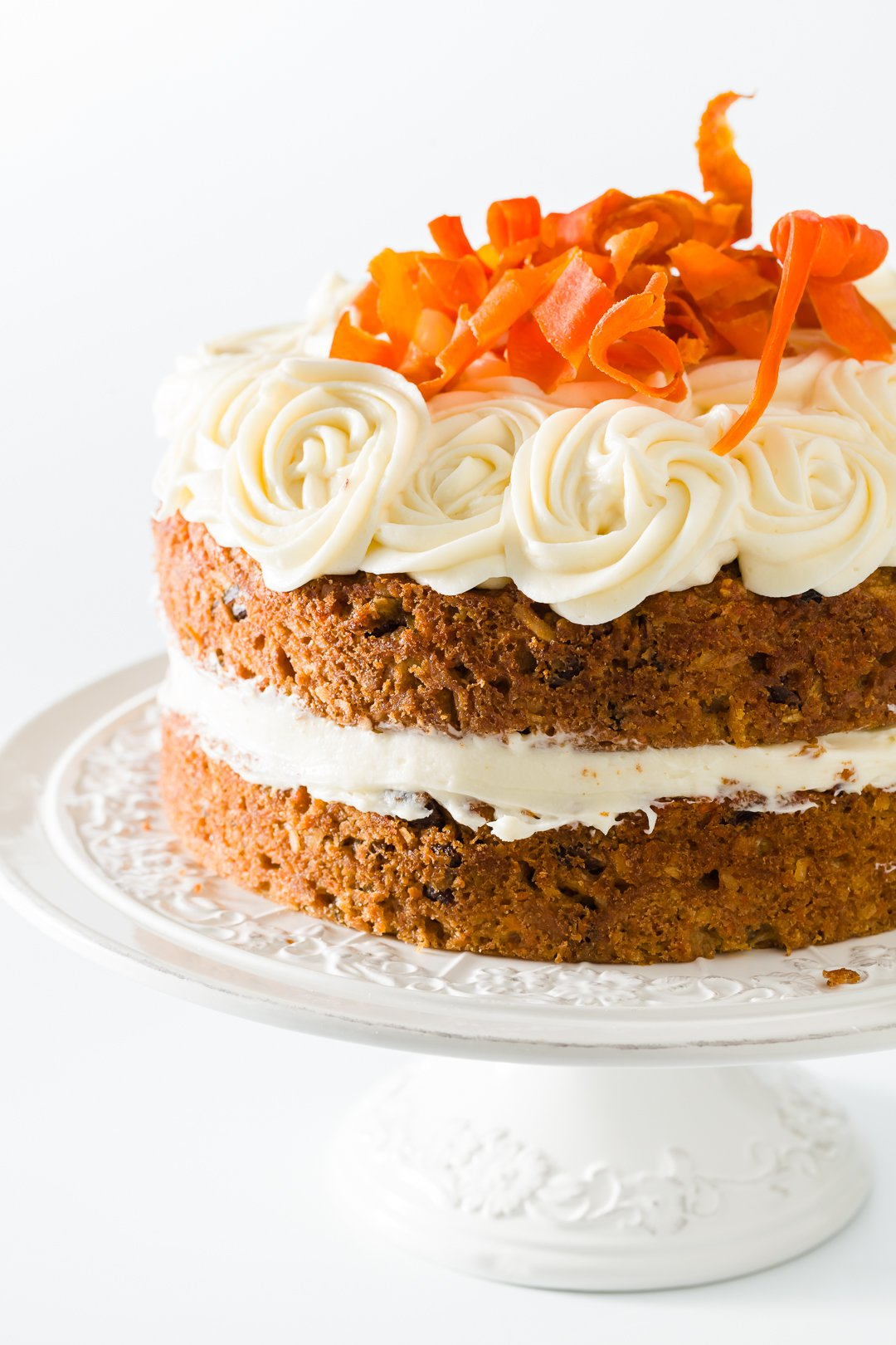 Two layer carrot cake on a cake stand